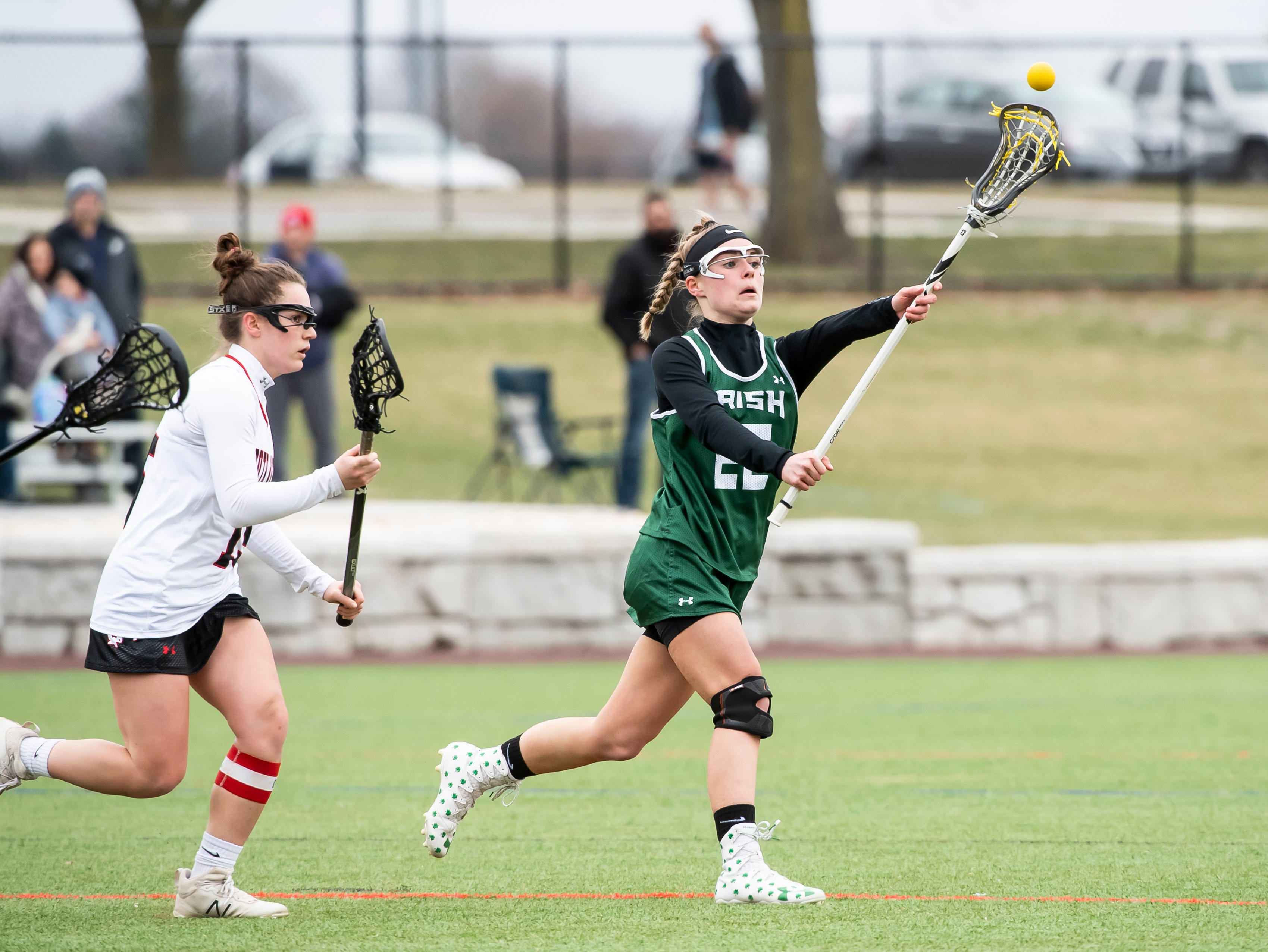 York Catholic's Natalie Neiman passes the ball during a YAIAA lacrosse game against South Western in Hanover on Tuesday, April 2, 2019. York Catholic won 19-7 and improved to 5-0.