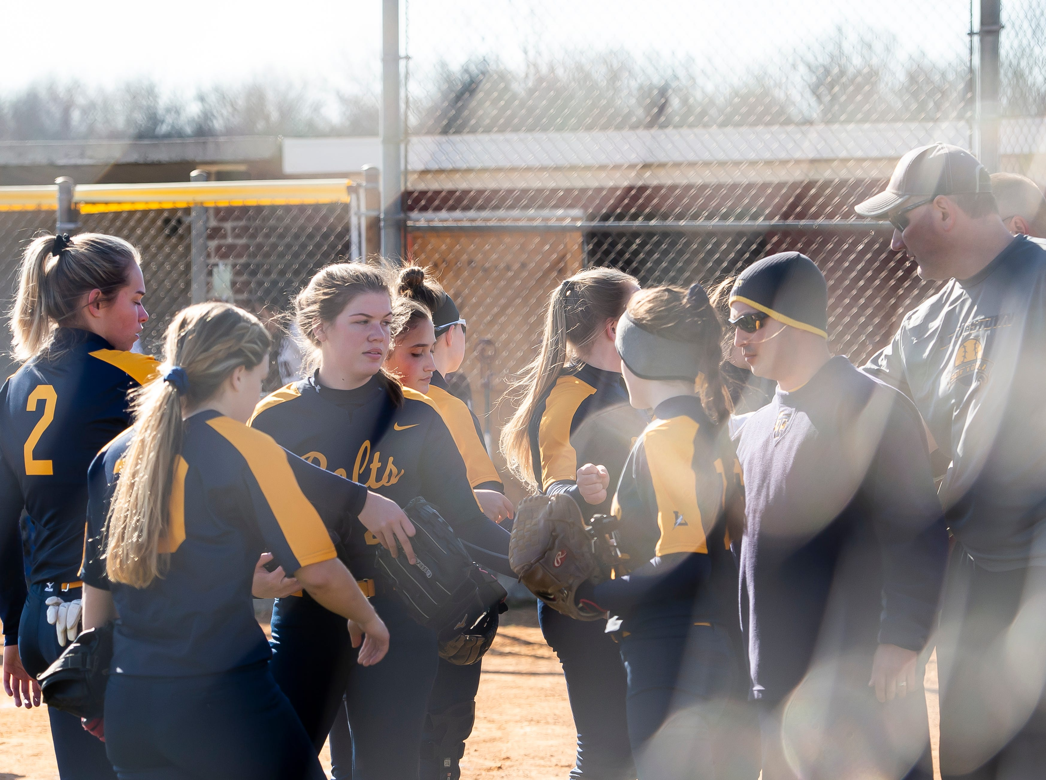 Littlestown players and coaches talk together outside the dugout between innings of a YAIAA softball game against Gettysburg on Monday, April 1, 2019. The Bolts won 10-4.