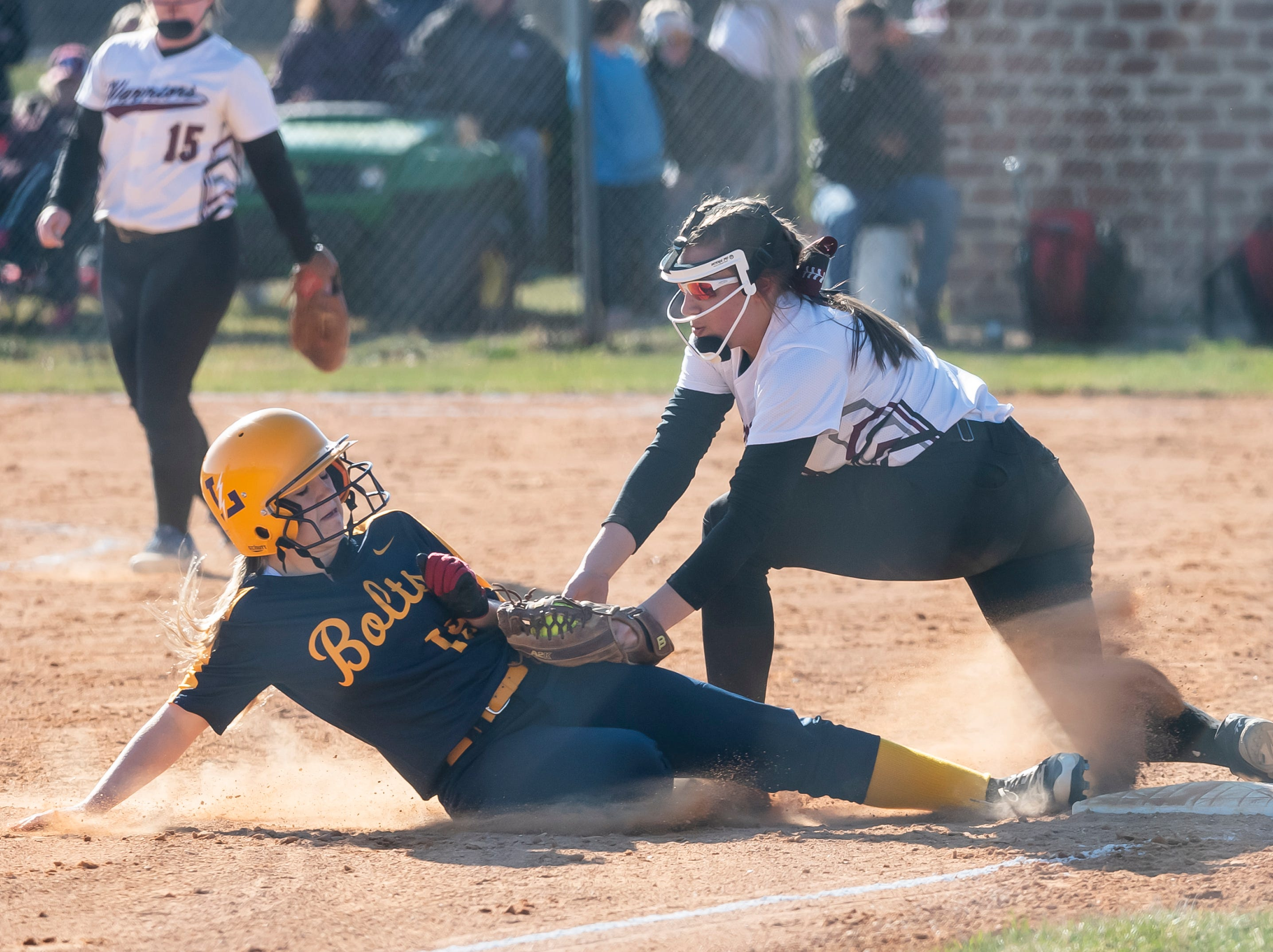 Gettysburg's Kaelyn Blocher tags out Littlestown's Carli Thayer at third base during a YAIAA softball game on Monday, April 1, 2019. The Warriors fell 10-4.