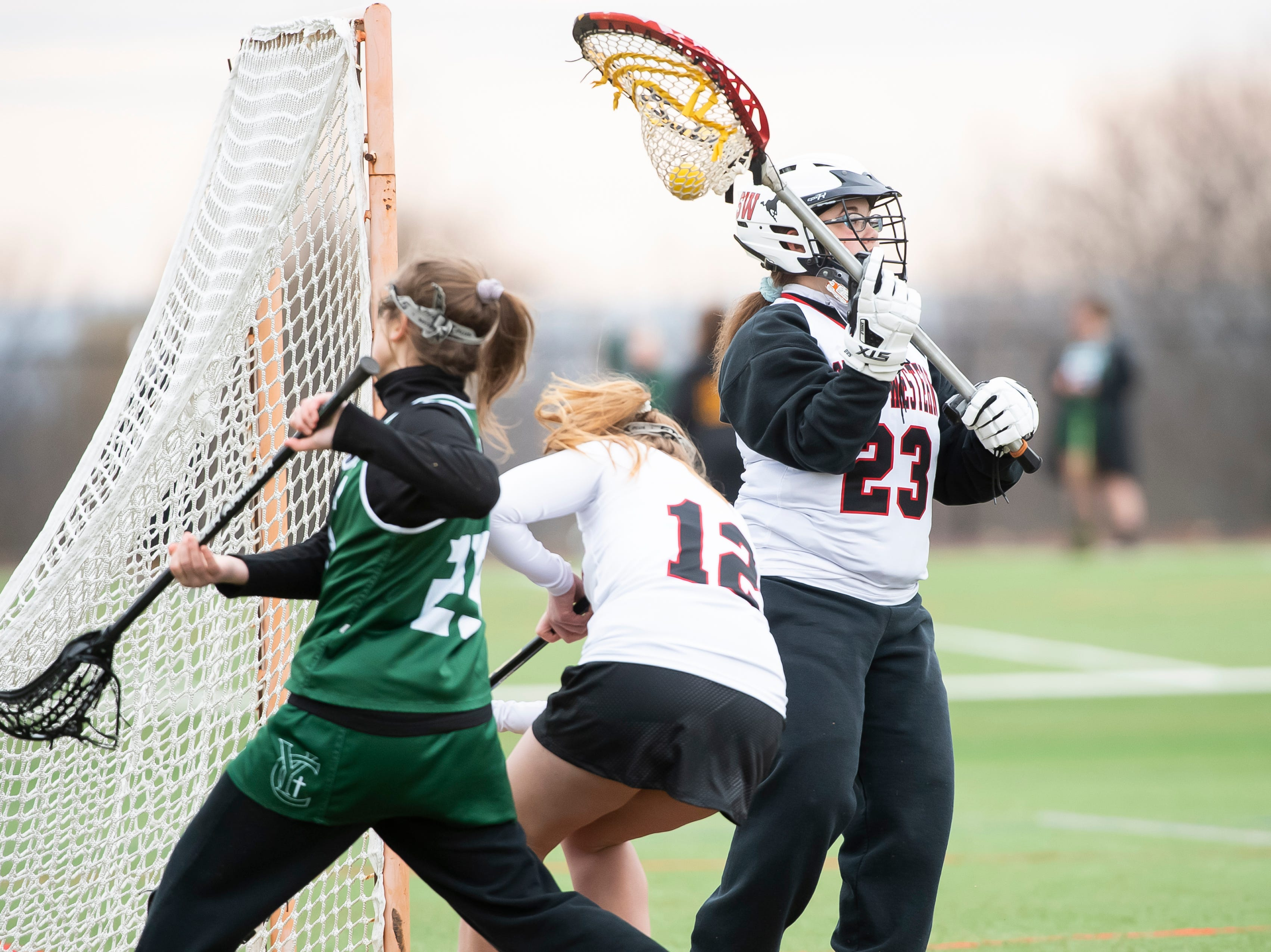 South Western goalie Morgan Melucci makes a save during a YAIAA lacrosse game against York Catholic in Hanover on Tuesday, April 2, 2019. Melucci had eight saves as York Catholic won 19-7.