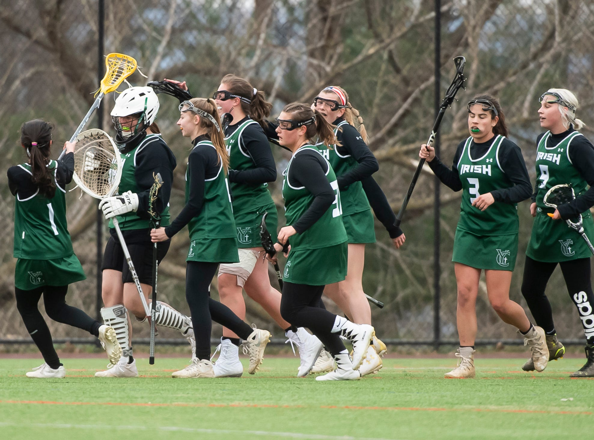 The York Catholic girls lacrosse team celebrate after defeating South Western 19-7 on Tuesday, April 2, 2019.