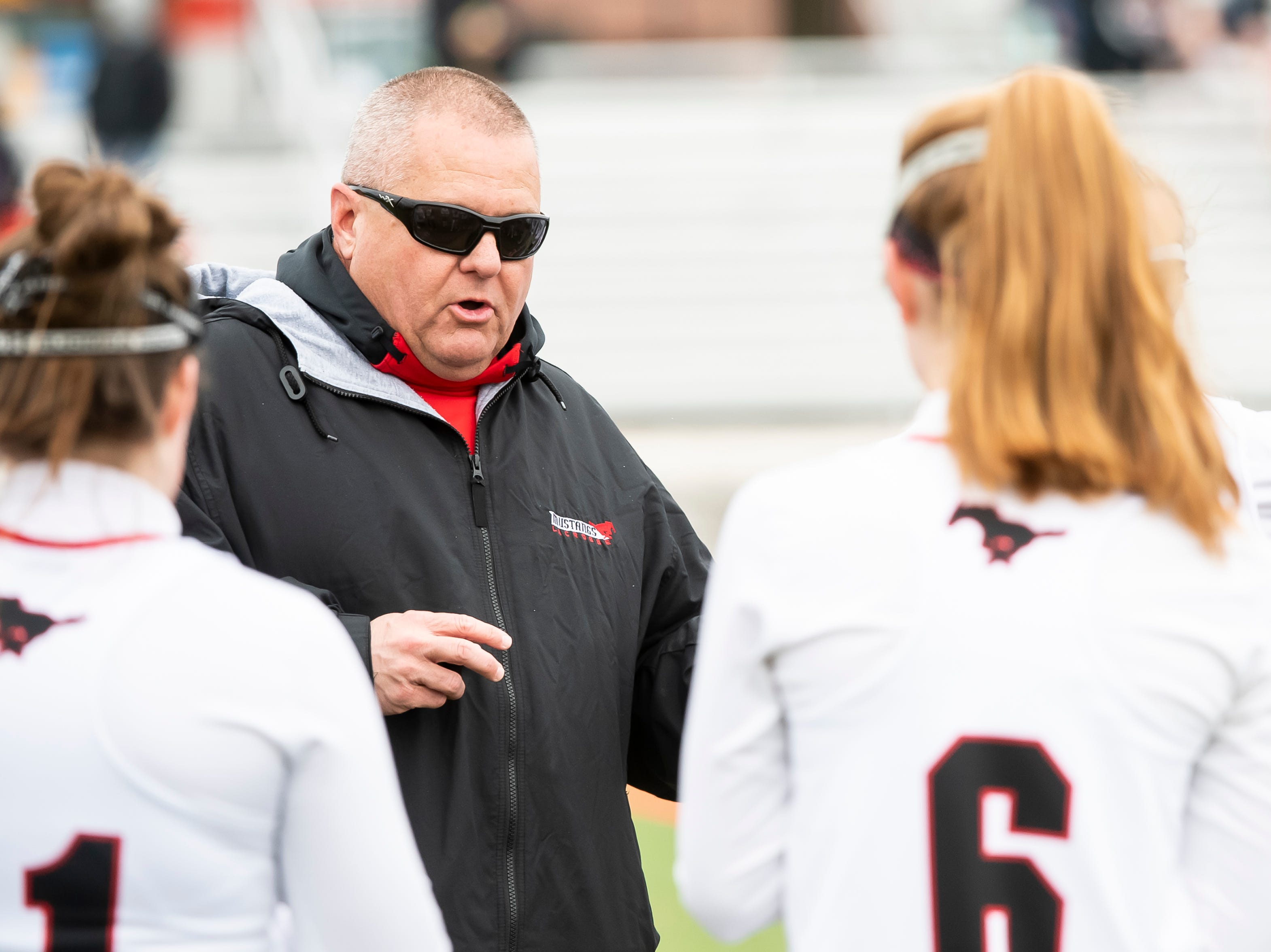 South Western girls lacrosse head coach Randy Kavanaugh speaks with his team during halftime in a YAIAA lacrosse game against York Catholic in Hanover on Tuesday, April 2, 2019. South Western fell 19-7.