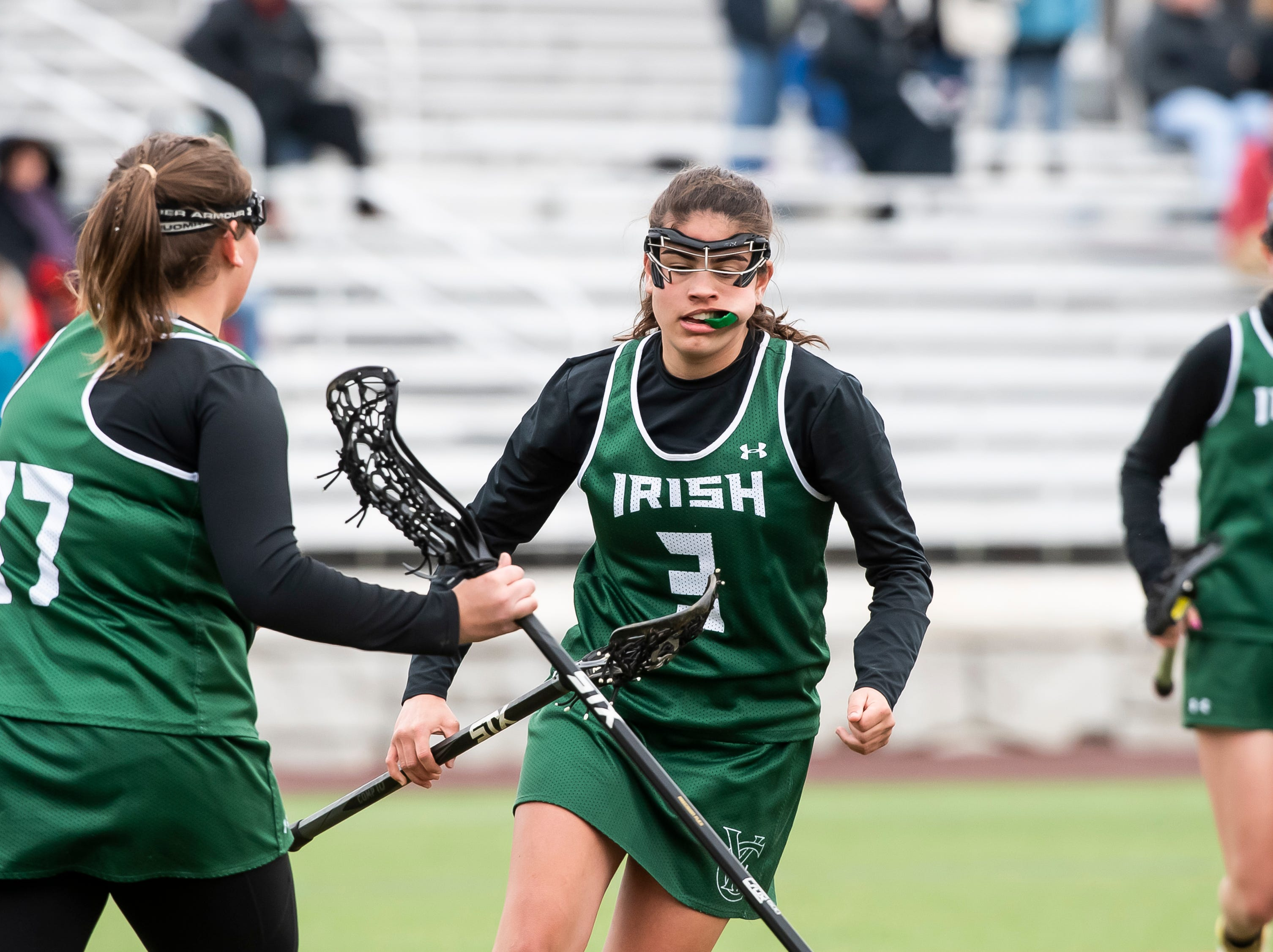 York Catholic's Shannon Staples (3) taps sticks with Ella Linthicum (37) after scoring a goal during a YAIAA lacrosse game against South Western on Tuesday, April 2, 2019. Staples had two goals as York Catholic won 19-7 and improved to 5-0.