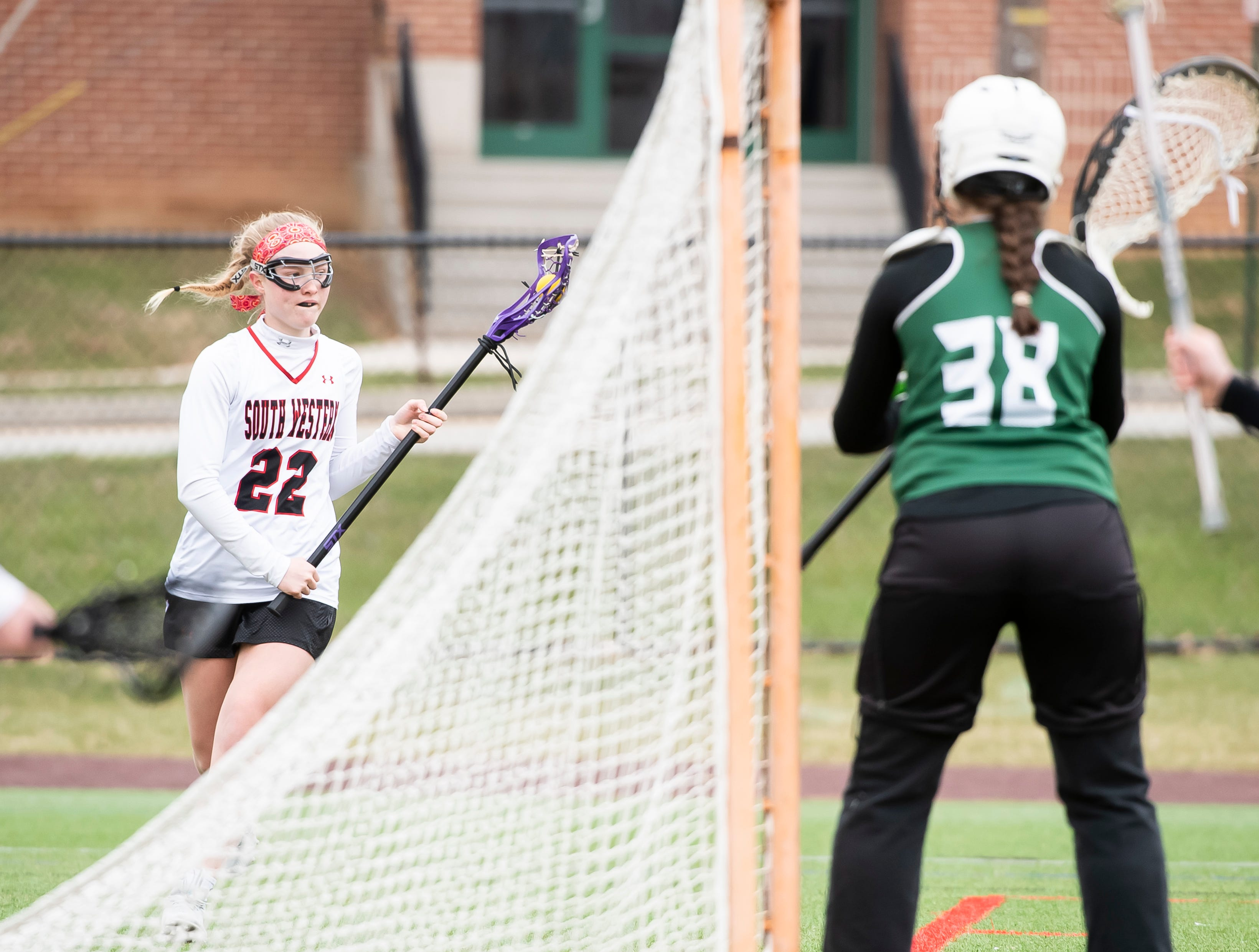 South Western's Aunnie Hacker (22) controls the ball near the net during a YAIAA lacrosse game against York Catholic in Hanover on Tuesday, April 2, 2019. South Western fell 19-7. Hacker finished the game with two goals, two assists, four ground balls and six shots on goal.