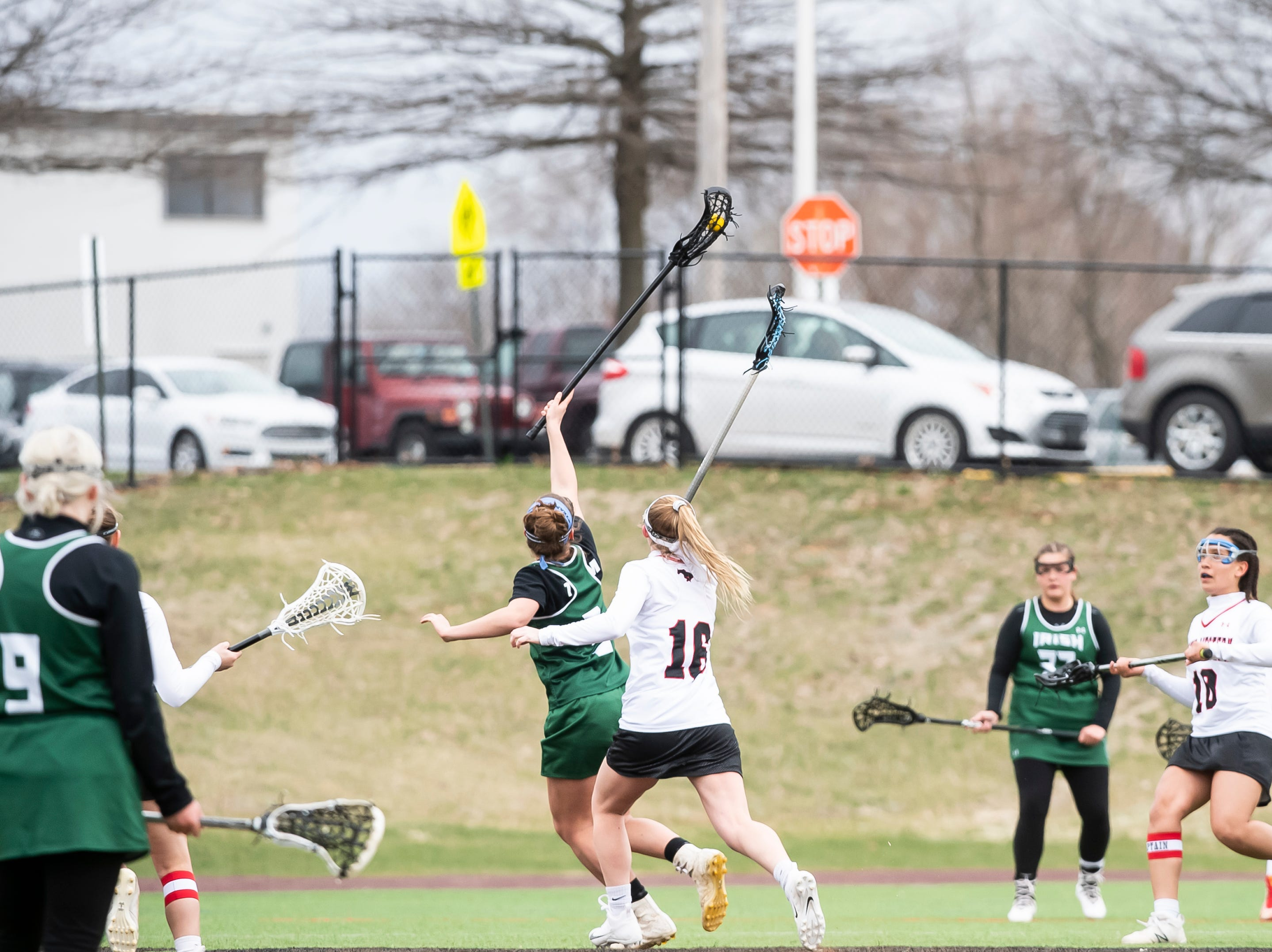York Catholic's Grace Doyle wins a face-off against South Western's Molly Watts during a YAIAA lacrosse game in Hanover on Tuesday, April 2, 2019. York Catholic won 19-7 and improved to 5-0.