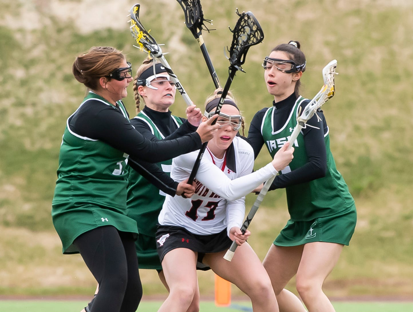 South Western's Libby Benzing gets trapped by a trio of York Catholic defenders during a YAIAA lacrosse game in Hanover on Tuesday, April 2, 2019. South Western fell 19-7.