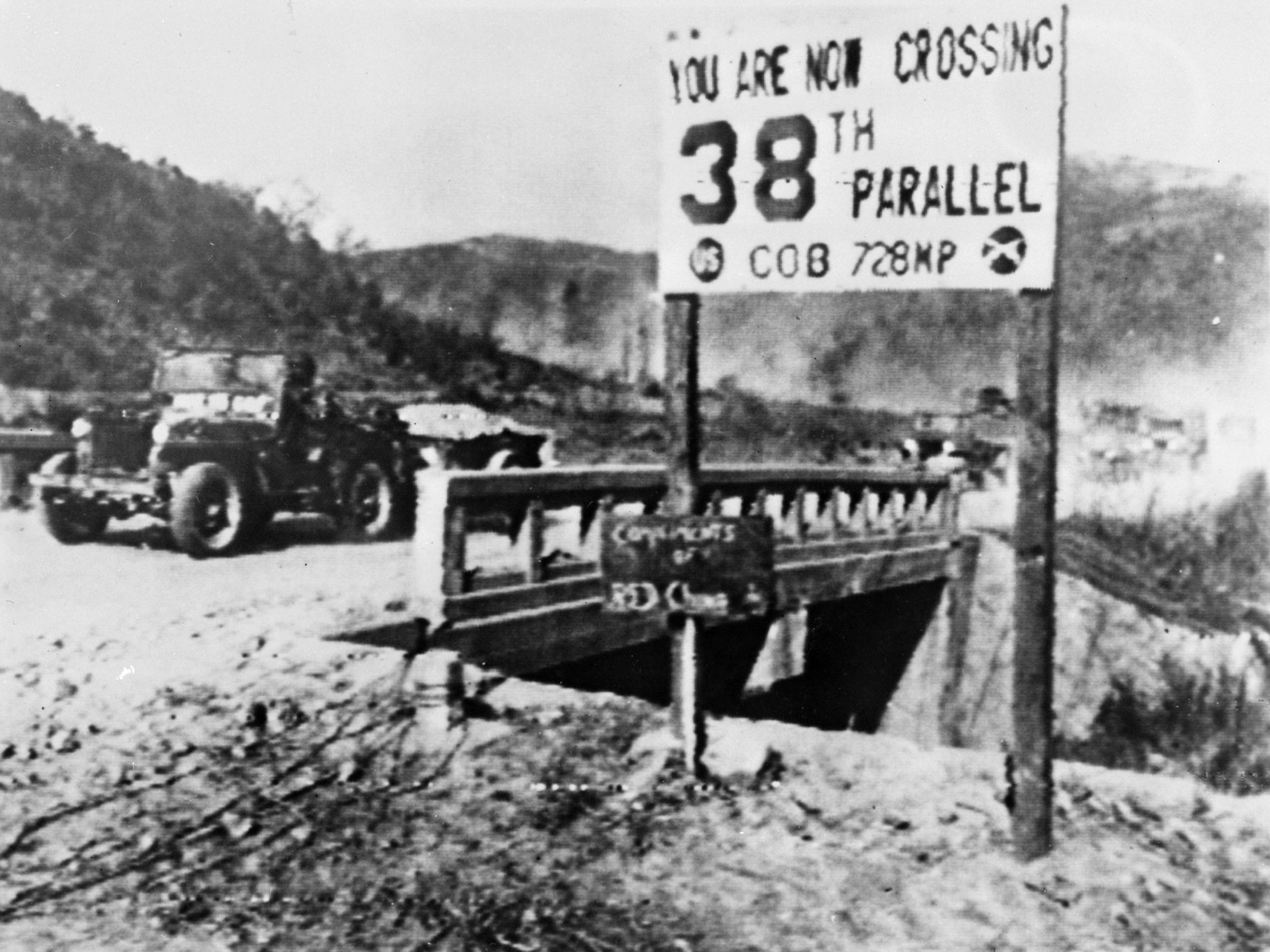 A jeep heading south crossing the 38th parallel separating North and South Korea in December 1950.