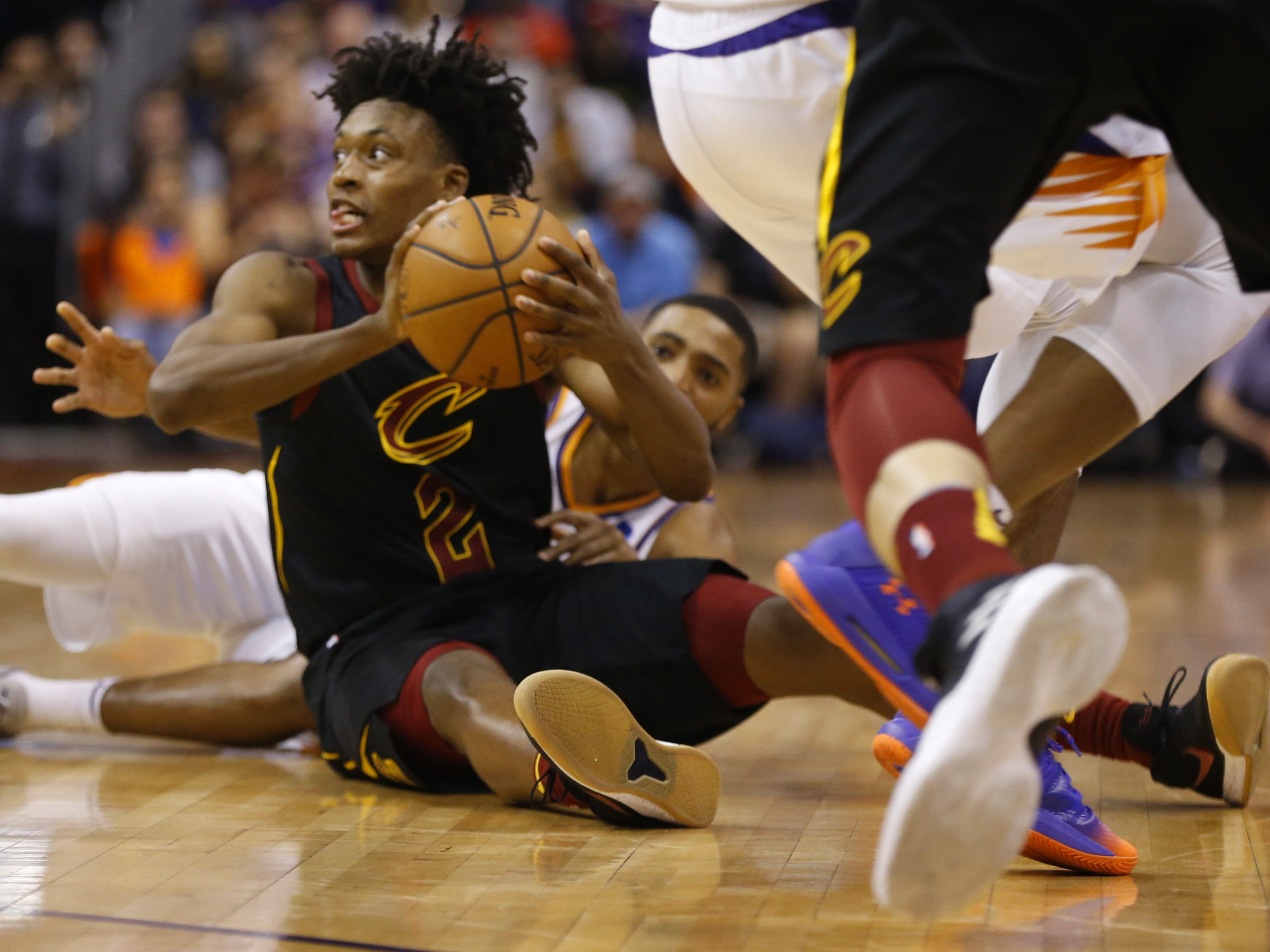 Cavaliers' Collin Sexton (2) recovers a loose ball against Suns' Mikal Bridges during the second half at Talking Stick Resort Arena in Phoenix, Ariz. on April 1, 2019.
