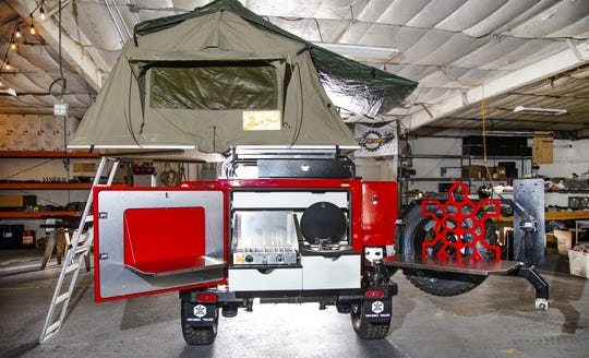 This shows where the stove and the sink and storage is on a Turtleback Trailer.