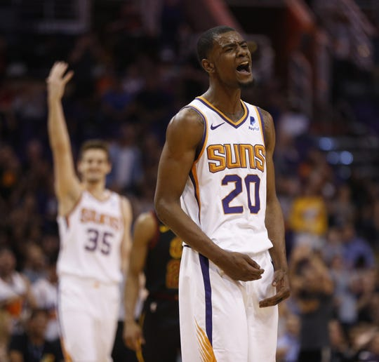 Suns' Josh Jackson (20) reacts after making a dunk and then blocking Cavaliers' Brandon Knight on the next possession during the second half at Talking Stick Resort Arena in Phoenix, Ariz. on April 1, 2019.