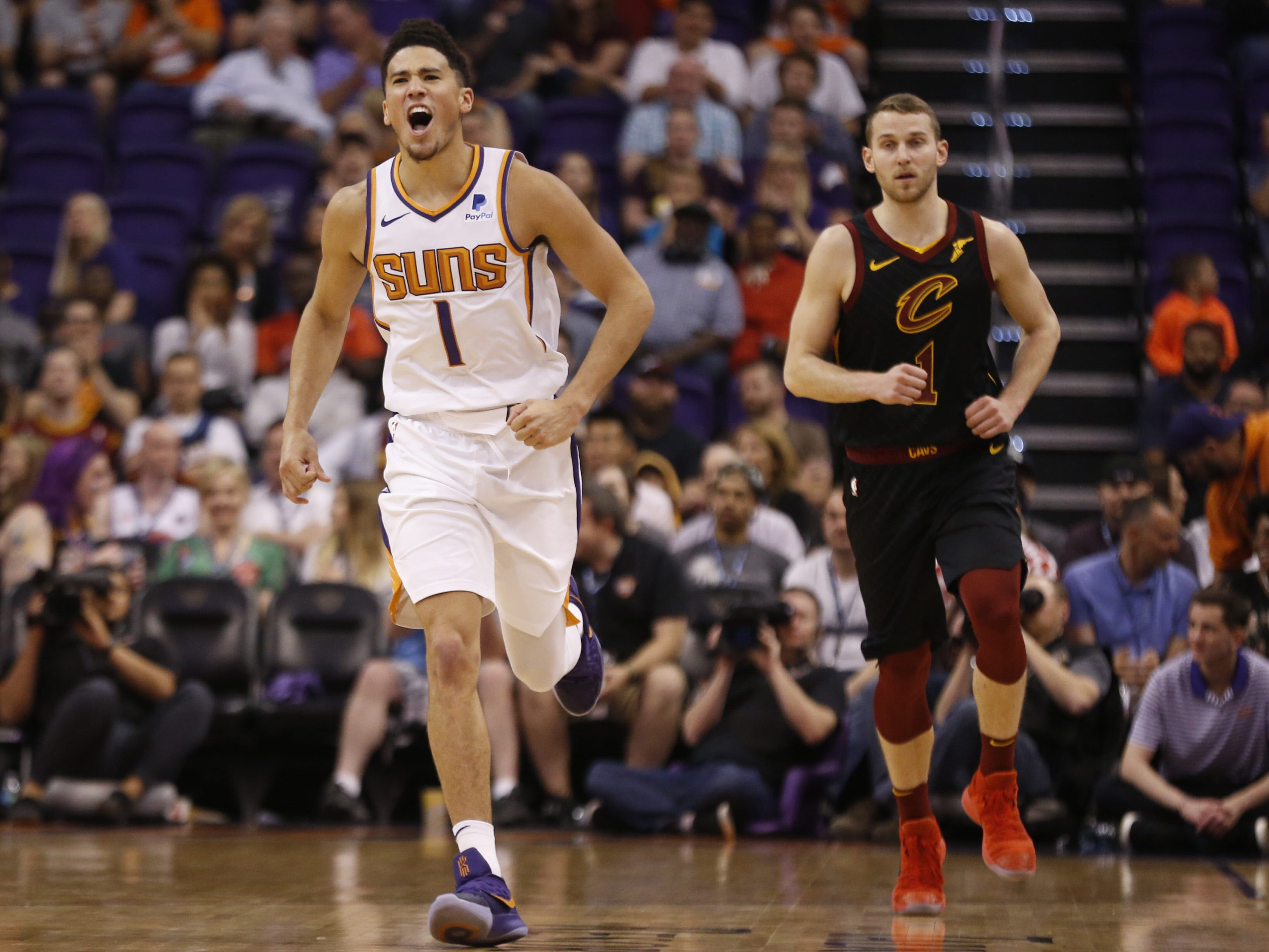Suns' Devin Booker (1) celebrates a basket against the Cavaliers during the fourth quarter at Talking Stick Resort Arena in Phoenix, Ariz. on April 1, 2019.