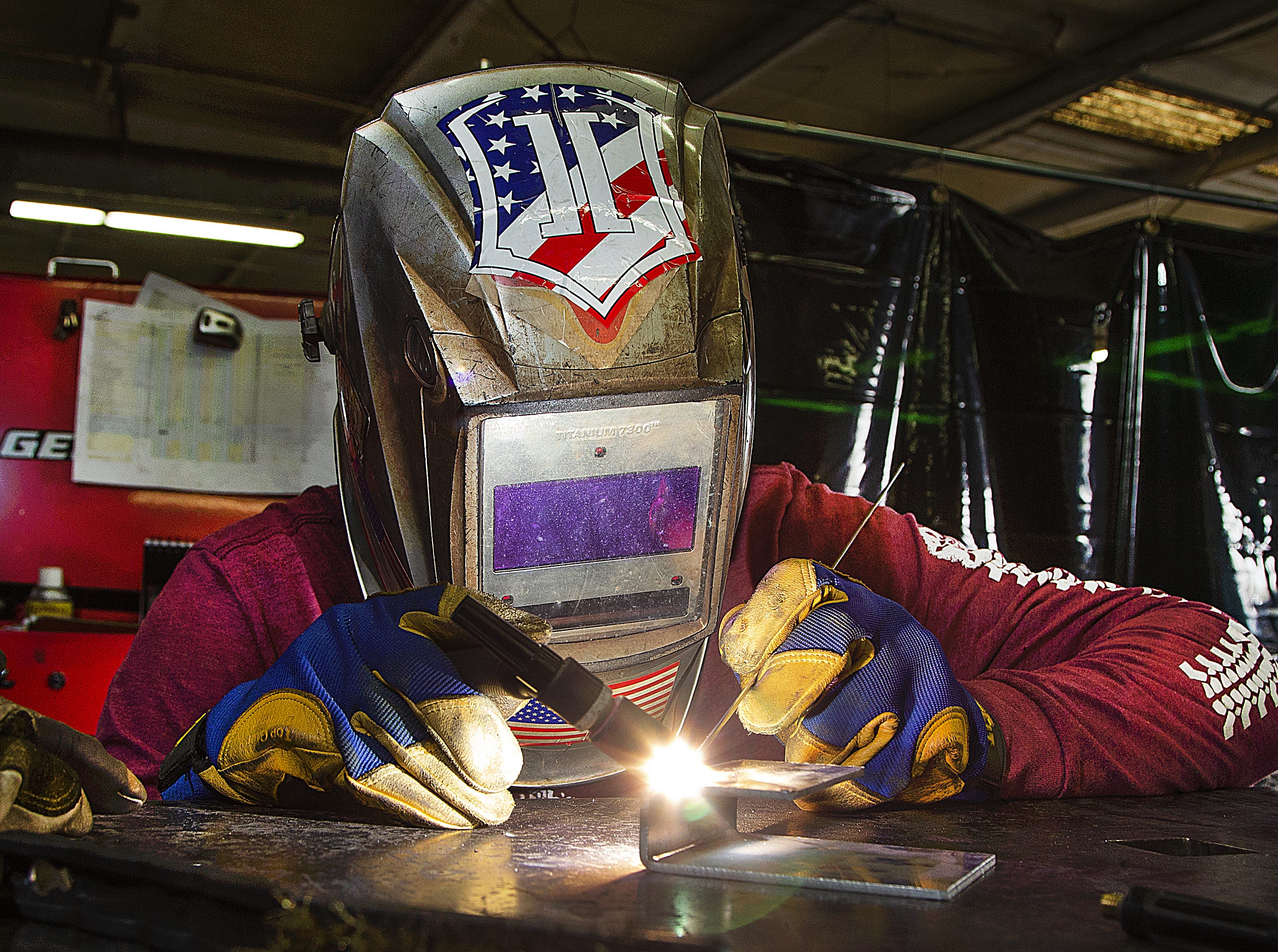 Douglas Murray welds part of a piece for a Turtleback trailer at the company plant near 14th Street and Broadway in Phoenix on March 26, 2019.