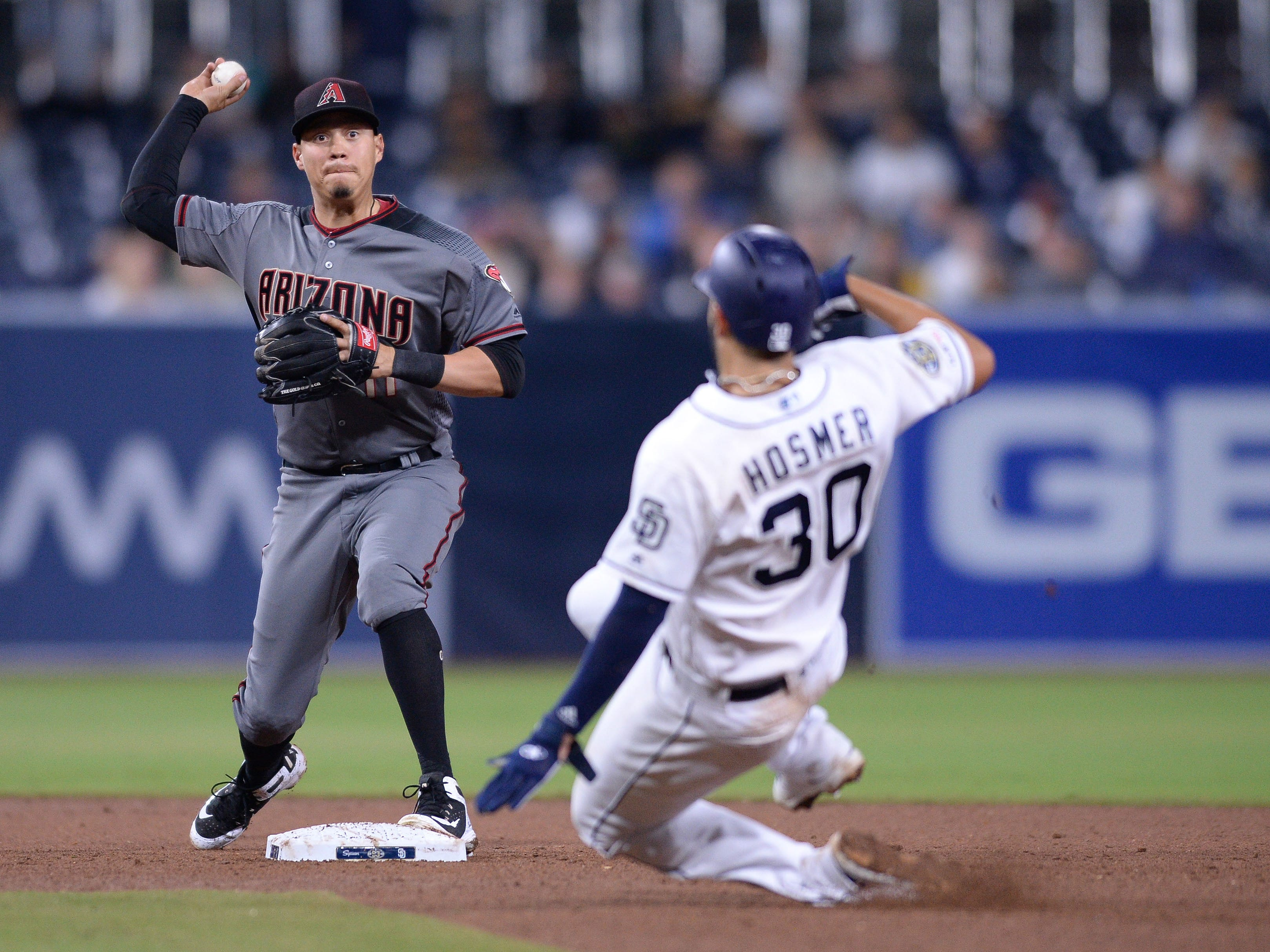Apr 1, 2019: Arizona Diamondbacks second baseman Wilmer Flores (left) forces out San Diego Padres first baseman Eric Hosmer (30) at second base before throwing to first base to complete the double play during the eighth inning at Petco Park.