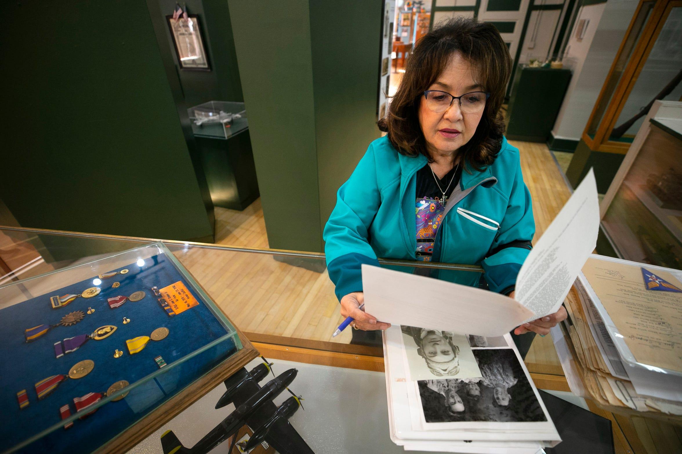 Jennie Campos looks at documents, photos and military medals pertaining to her father, Joe Campos, at the Bullion Plaza Cultural Center & Museum in Miami, Ariz., on January 24, 2019. It is believed that Staff Sgt. Joe Campos, a gunner on a B-26 bomber was likely the first American killed in the Korean War when his plane went down in the Yellow Sea on June 28, 1950. The museum is building a display about Joe Campos in their military exhibit.