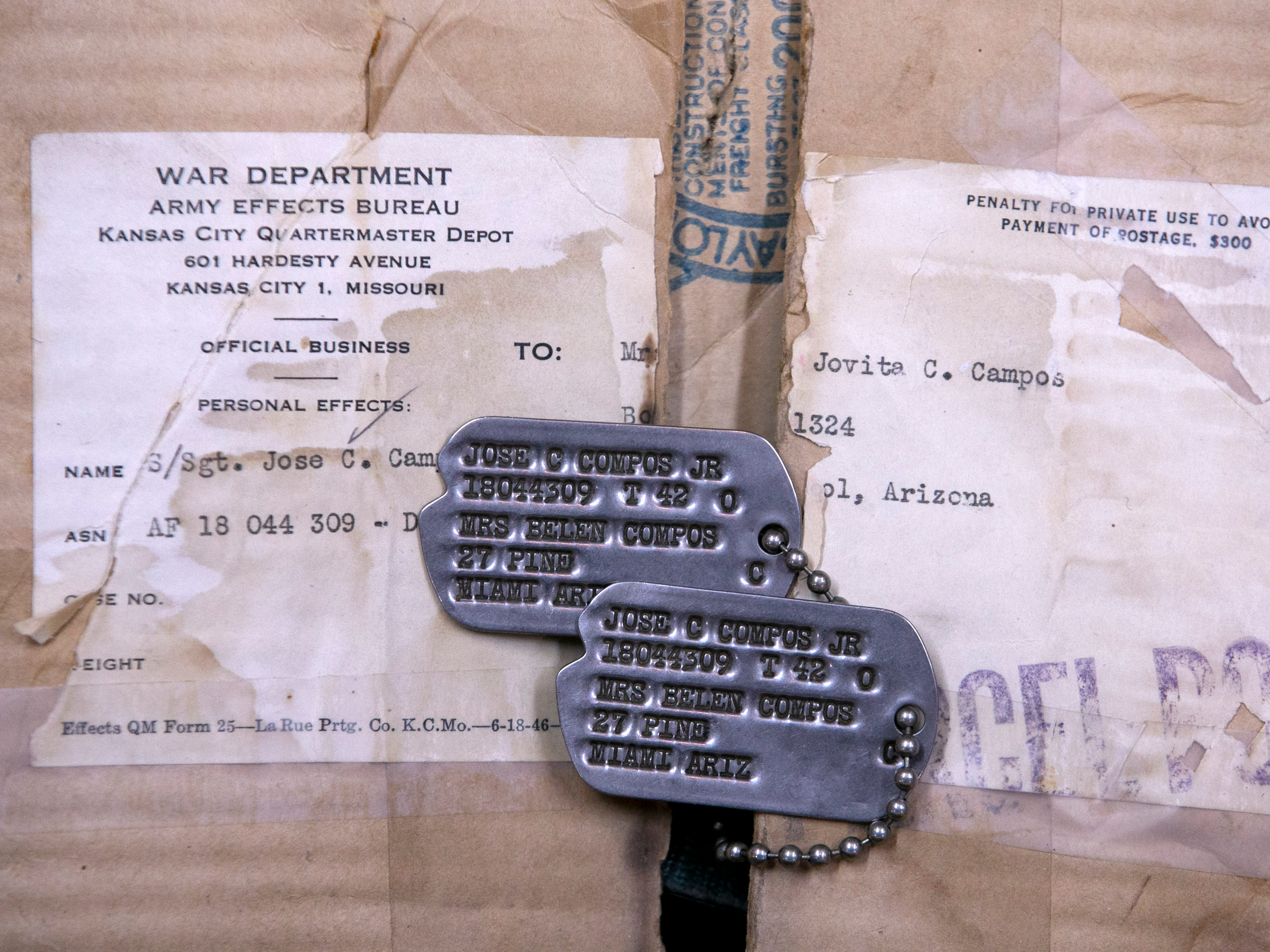 The dog tags of Airman Joe Campos who served during World War II in the European theater in 1943. After World War II Campos would re-enlist. It is believed that Staff Sgt. Joe Campos, a gunner on a B-26 bomber was likely the first American killed in the Korean War when his plane went down in the Yellow Sea on June 28, 1950.