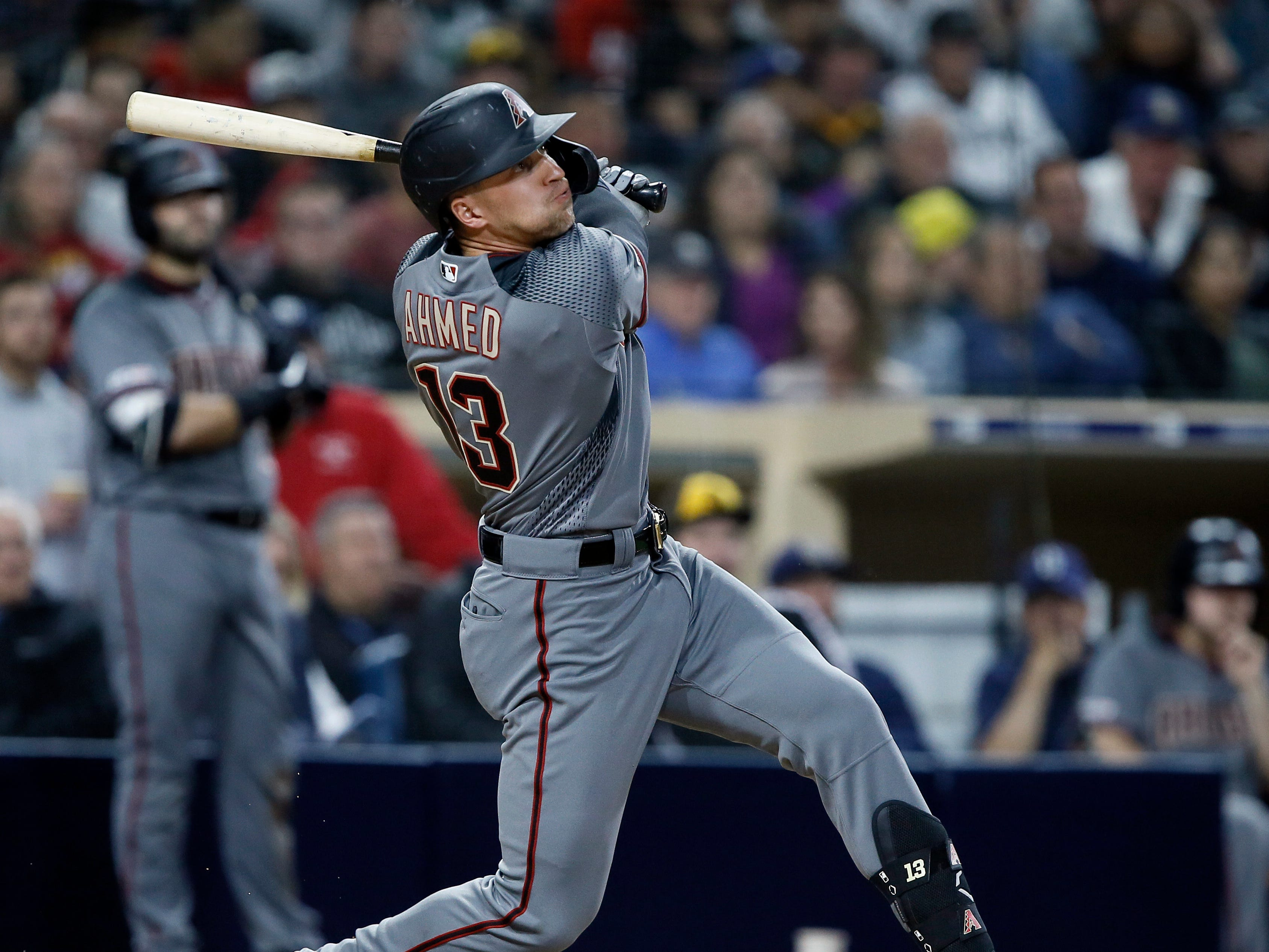 Arizona Diamondbacks' Nick Ahmed hits an RBI-sacrifice fly to right field to score David Peralta during the third inning of a baseball game against the San Diego Padres in San Diego, Monday, April 1, 2019. (AP Photo/Alex Gallardo)