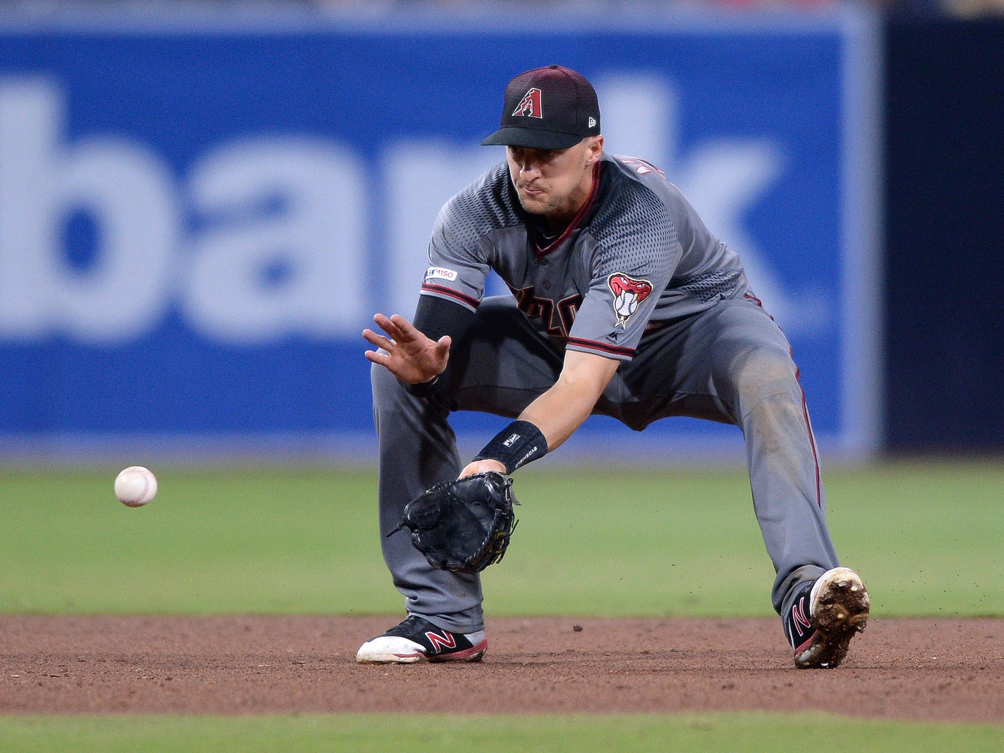 Apr 1, 2019: Arizona Diamondbacks shortstop Nick Ahmed (13) fields a ground ball hit by San Diego Padres relief pitcher Phil Maton (not pictured) before throwing to first base for the out during the seventh inning at Petco Park.