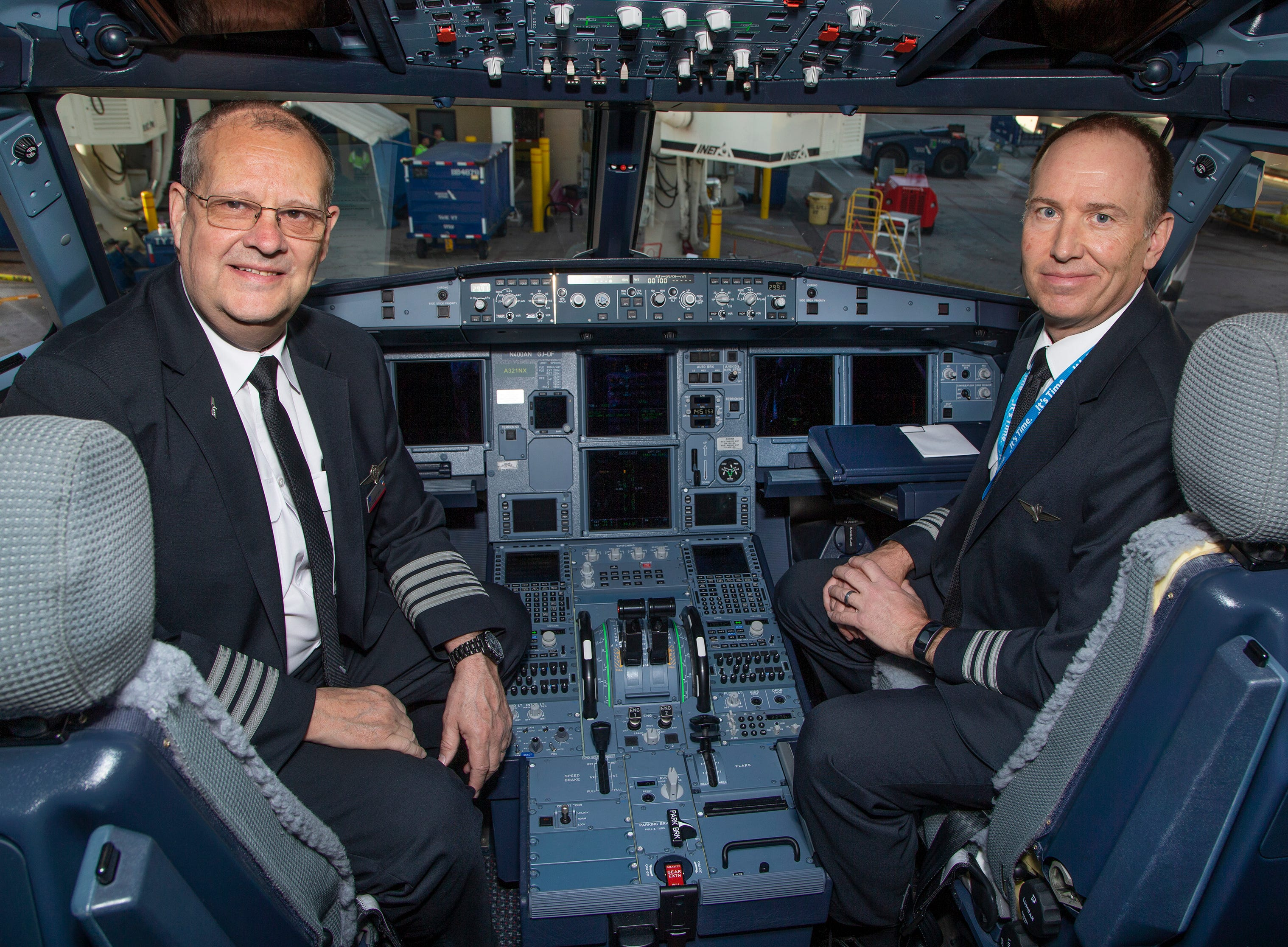 Captain Craig D.K. Jones, left, and First Officer Dan Tyger sit in the cockpit before the first flight which was from Phoenix Sky Harbor International Airport to Orlando, Florida on April 2, 2019.