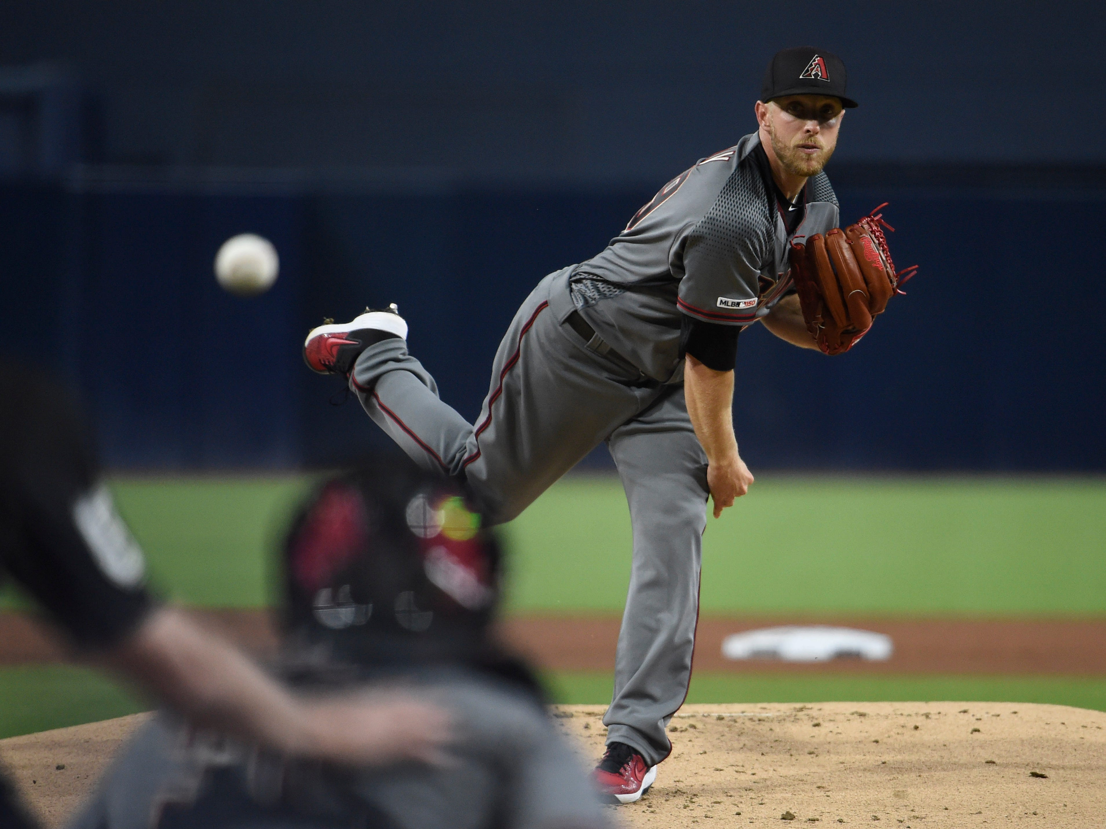 Merrill Kelly #29 of the Arizona Diamondbacks pitches during the first inning of a baseball game against the San Diego Padres at Petco Park April 1, 2019 in San Diego, California.