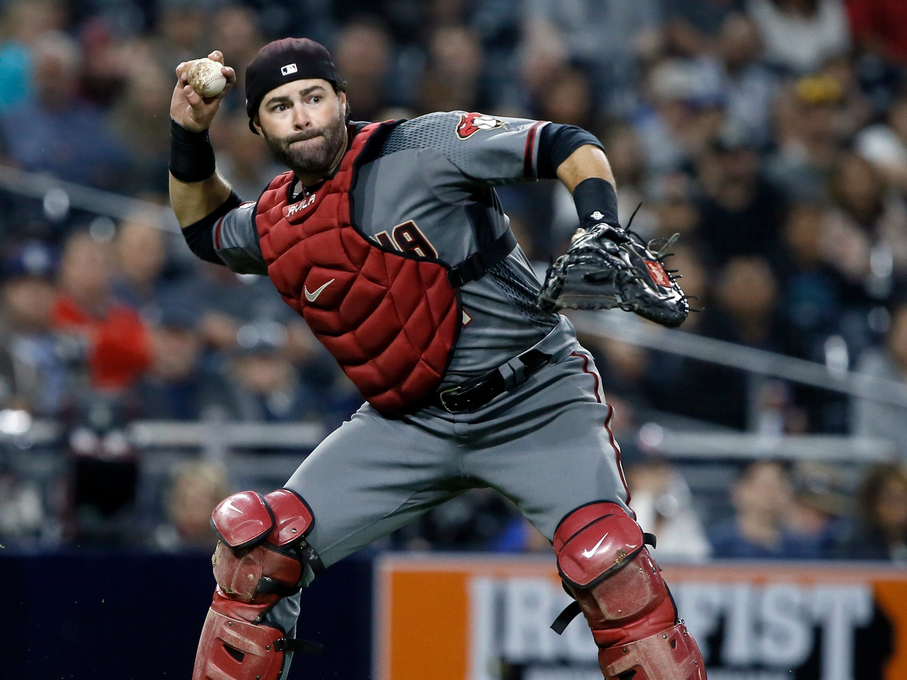 Arizona Diamondbacks catcher Alex Avila throws out San Diego Padres' Wil Myers on a ground out during the first inning of a baseball game in San Diego, Monday, April 1, 2019. (AP Photo/Alex Gallardo)