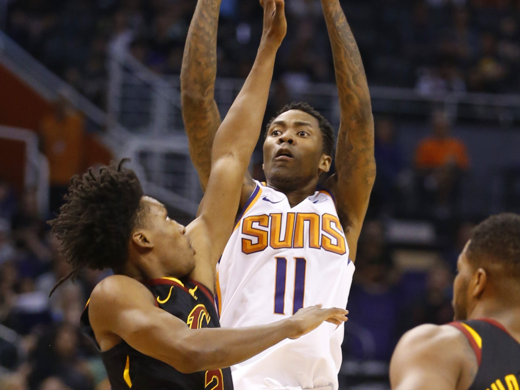 Suns' Jamal Crawford (11) hits a three and draws a foul on Cavaliers' Collin Sexton (2) during the first half at Talking Stick Resort Arena in Phoenix, Ariz. on April 1, 2019.