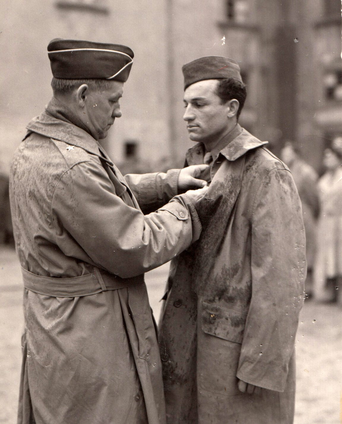 Airman Joe Campos (right) of the U.S. Army/Air Force receives a medal in Europe during World War II.