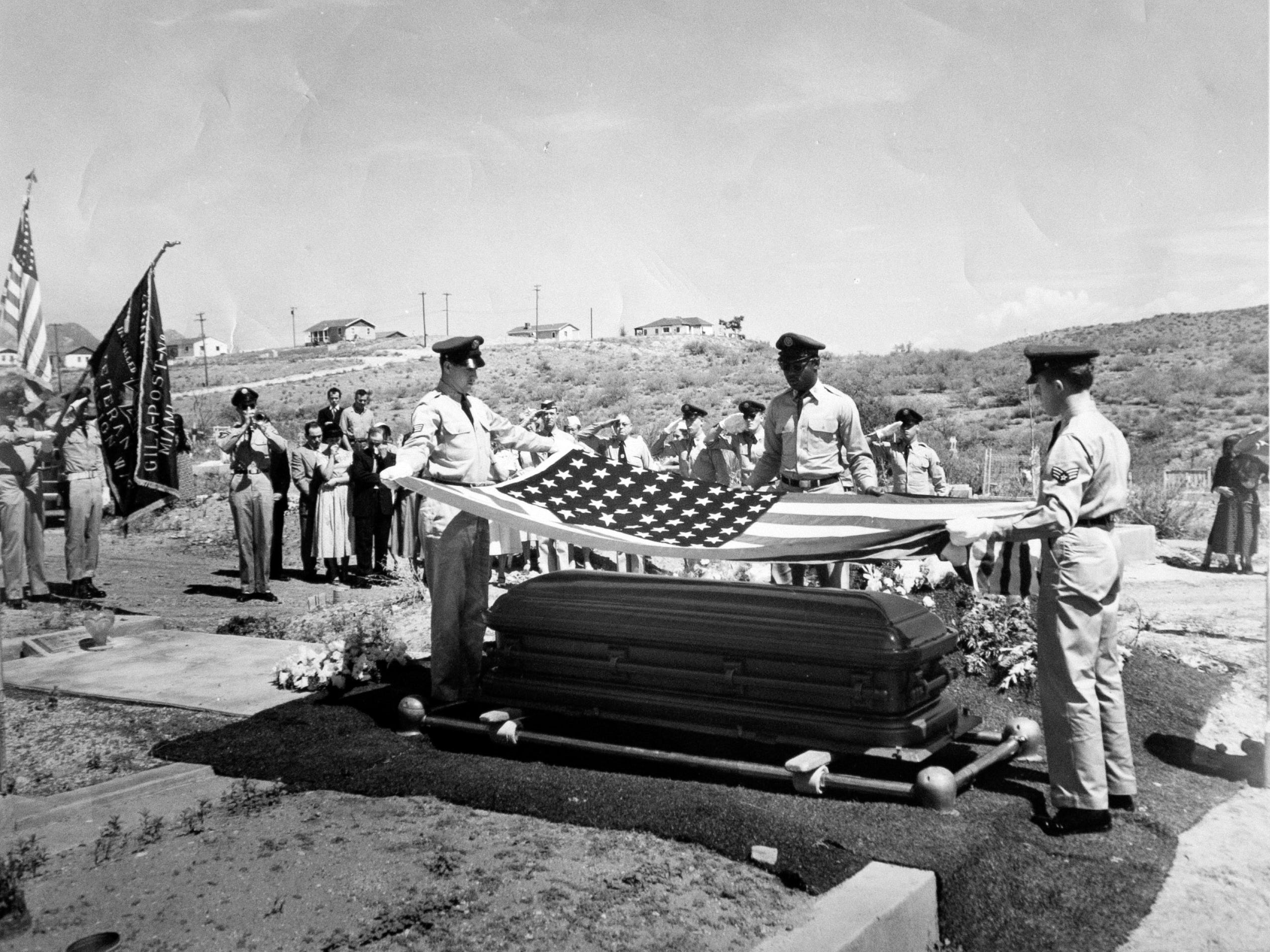 The funeral service for Staff Sgt. Joe Campos in Miami, Ariz., in July of 1953. Campos, a gunner on a B-26 bomber, was likely the first American killed in the Korean War when his plane went down in the Yellow Sea on June 28, 1950. It took nearly three years for his remains to be found and identified so he could receive a proper burial.