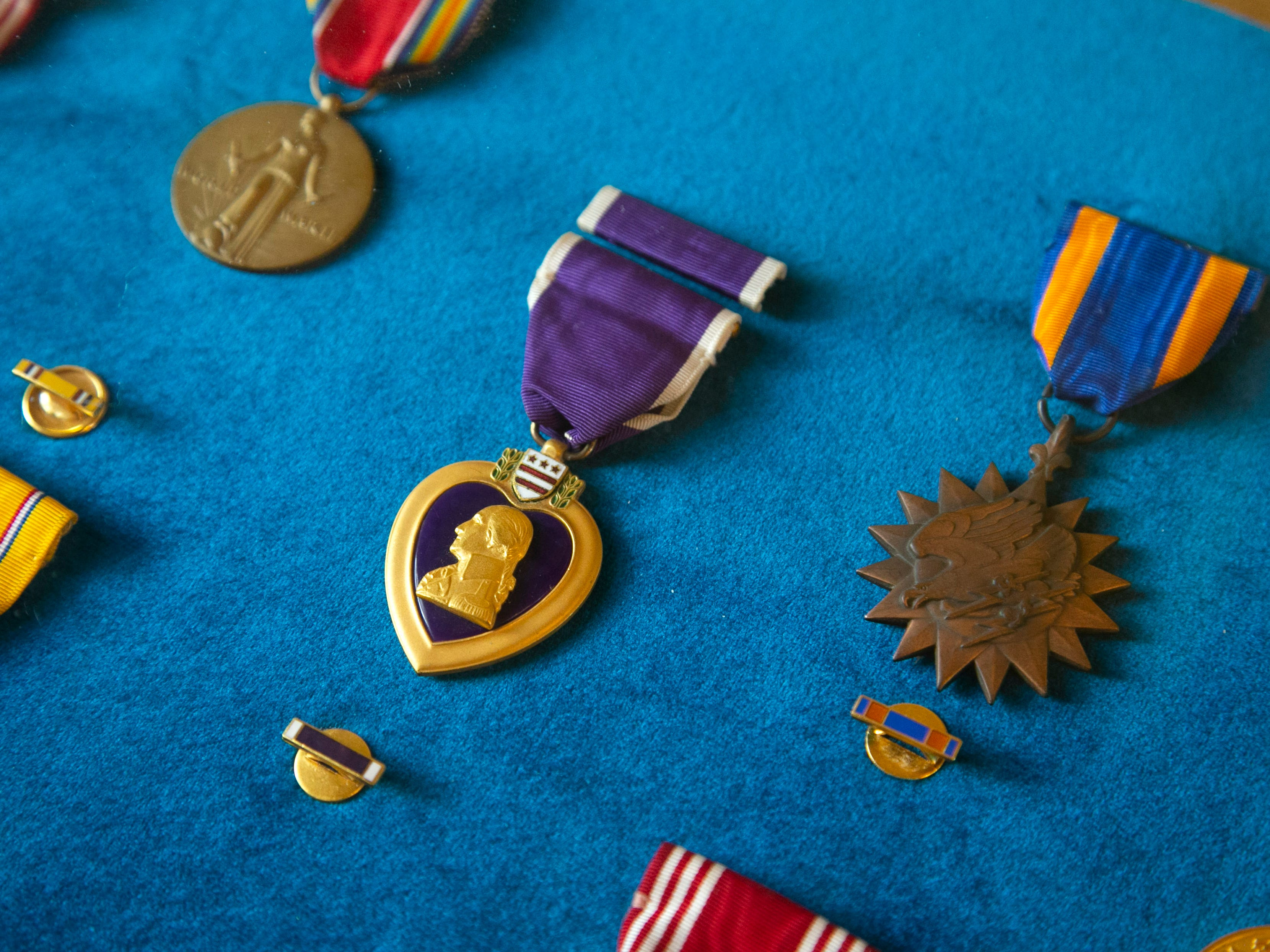 Military medals including the Purple Heart (center) won by Staff Sergeant Joe Campos who served in World War II and the Korean War. Campos, a gunner on a B-26 bomber was likely the first American killed in the Korean War when his plane went down in the Yellow Sea on June 28, 1950.
