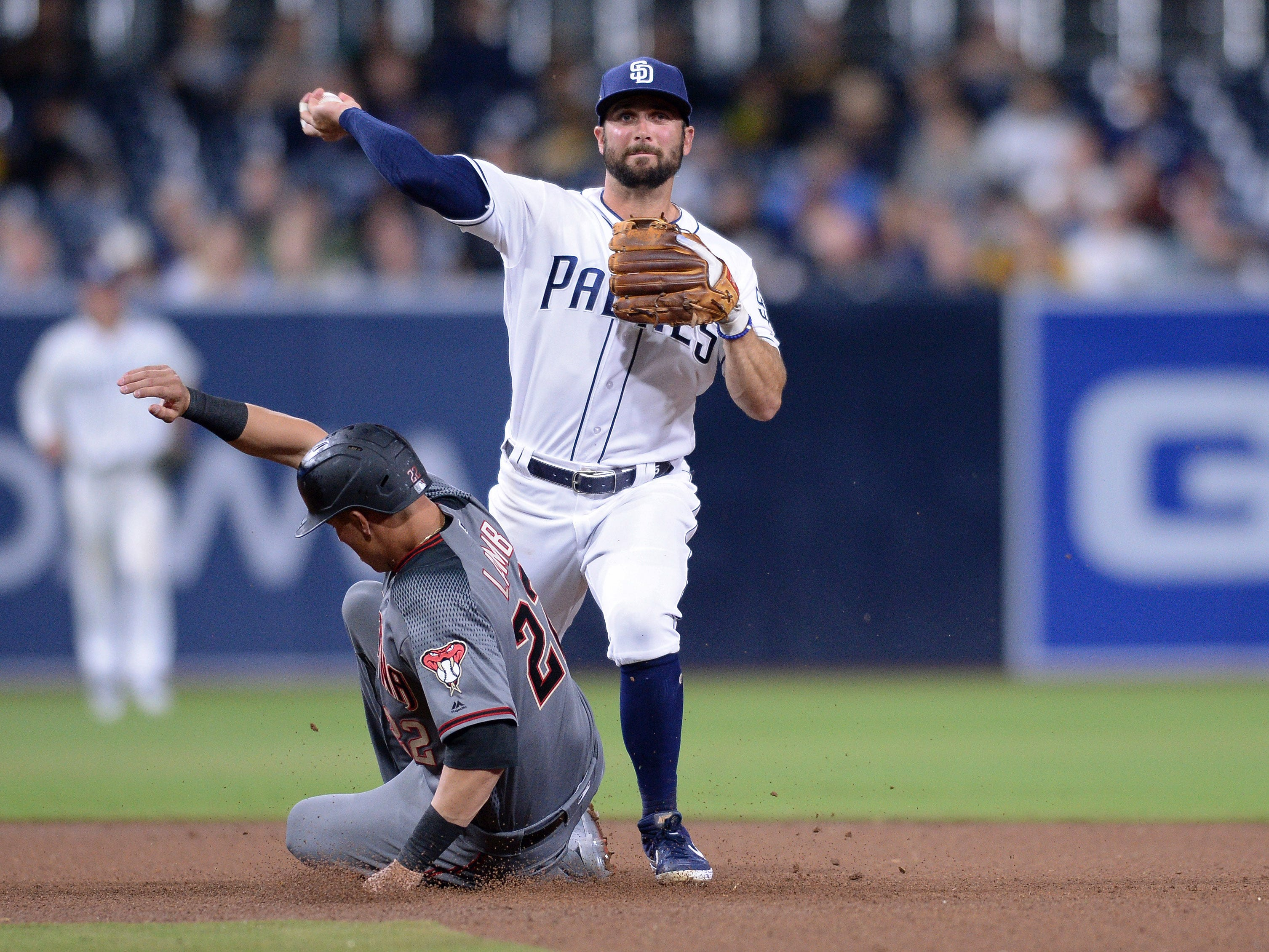 Apr 1, 2019: San Diego Padres third baseman Greg Garcia (5) forces out Arizona Diamondbacks third baseman Jake Lamb (22) at second base during the seventh inning at Petco Park.