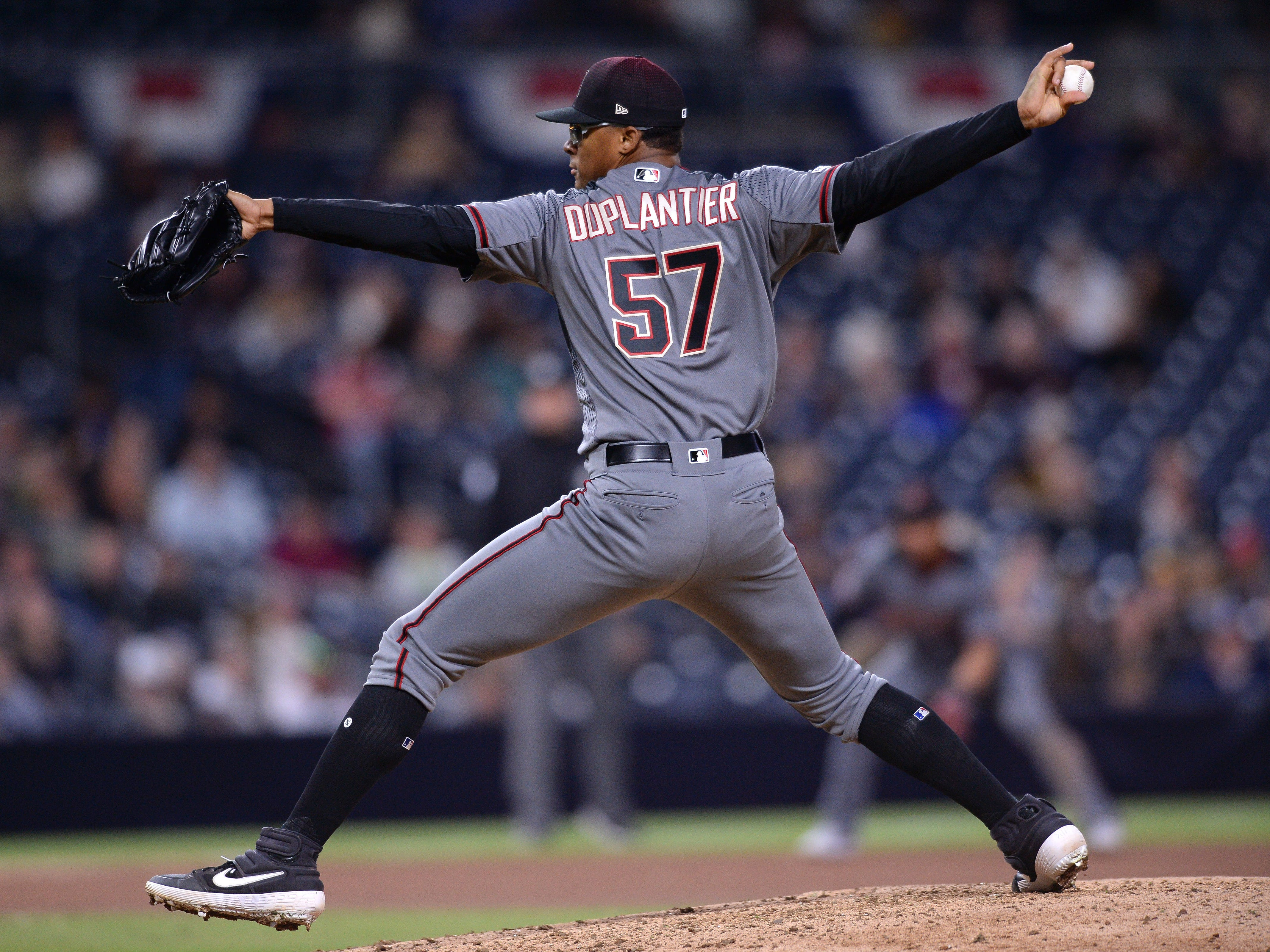 Diamondbacks relief pitcher Jon Duplantier (57) works against a Padres batter during the seventh inning of his major league debut at Petco Park on Monday.