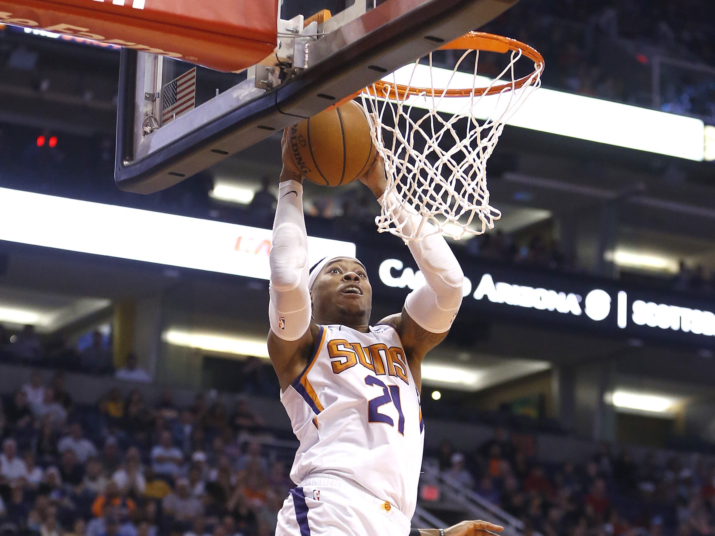 Suns' Richaun Holmes (21) catches an alleyoop and makes a layup and draws a foul against Cavaliers' David Nwaba (12) during the first half at Talking Stick Resort Arena in Phoenix, Ariz. on April 1, 2019.