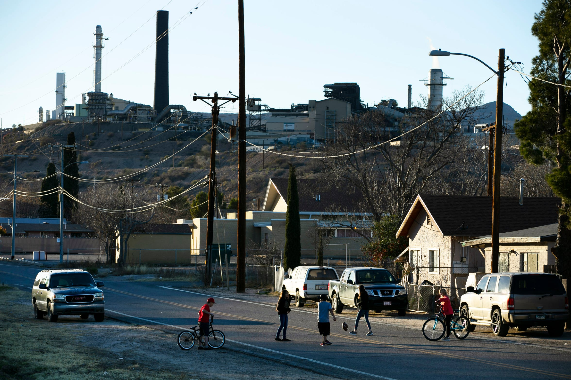 Children play on the street in Claypool, Ariz., in front of of the Freeport-Mcmoran Copper & Gold mine in Claypool on January 24, 2019. Joe Campos worked at this mine in the late 1940s which was then the Inspiration Consolidated Copper Company mine.