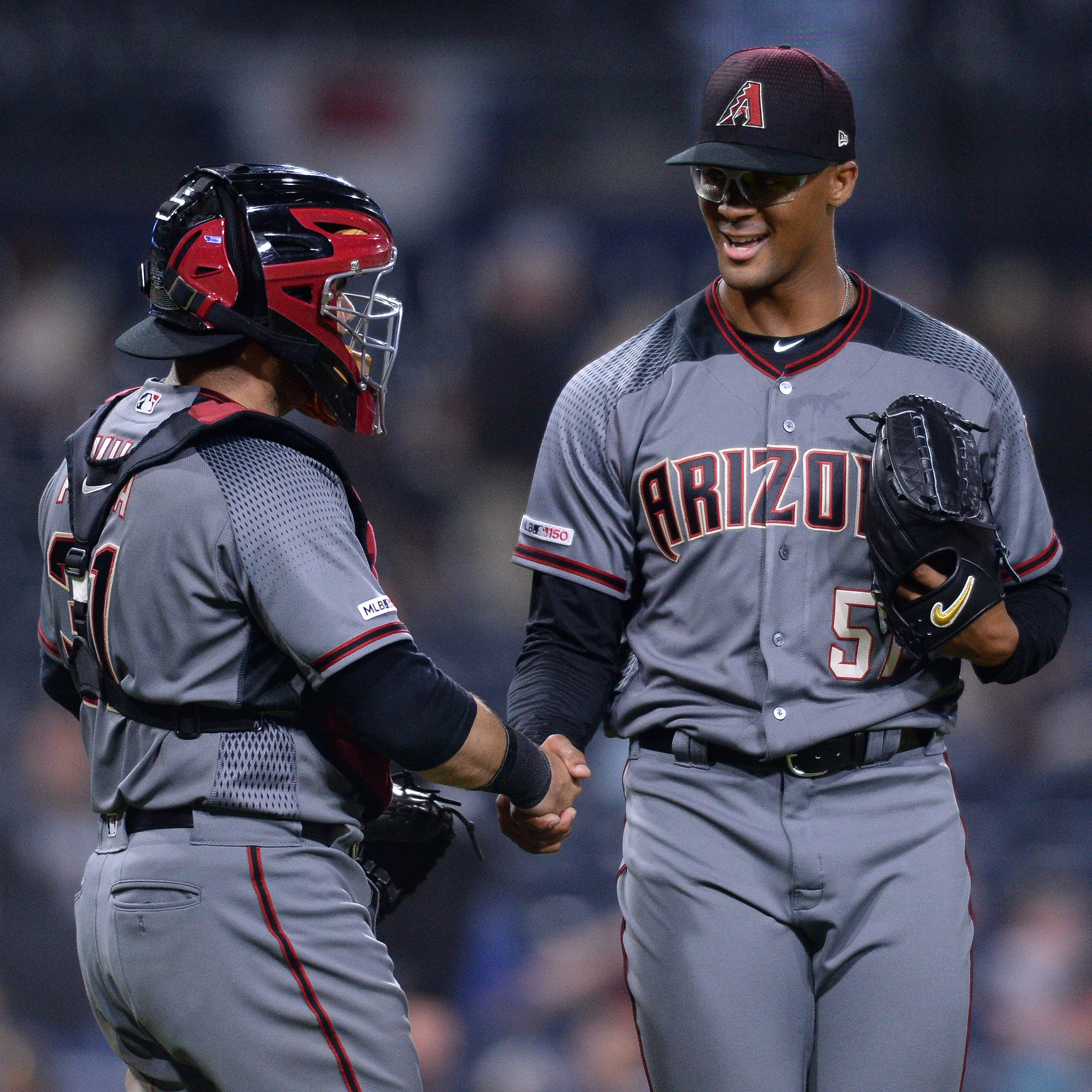 Diamondbacks' pair of pitching debuts notches first recorded win-save combo in win over Padres
