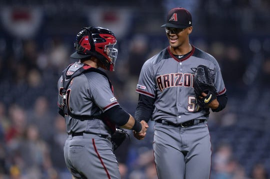 Diamondbacks pitcher Jon Duplantier shakes hands with catcher Alex Avila after securing his first career save in his MLB debut on Monday in San Diego.