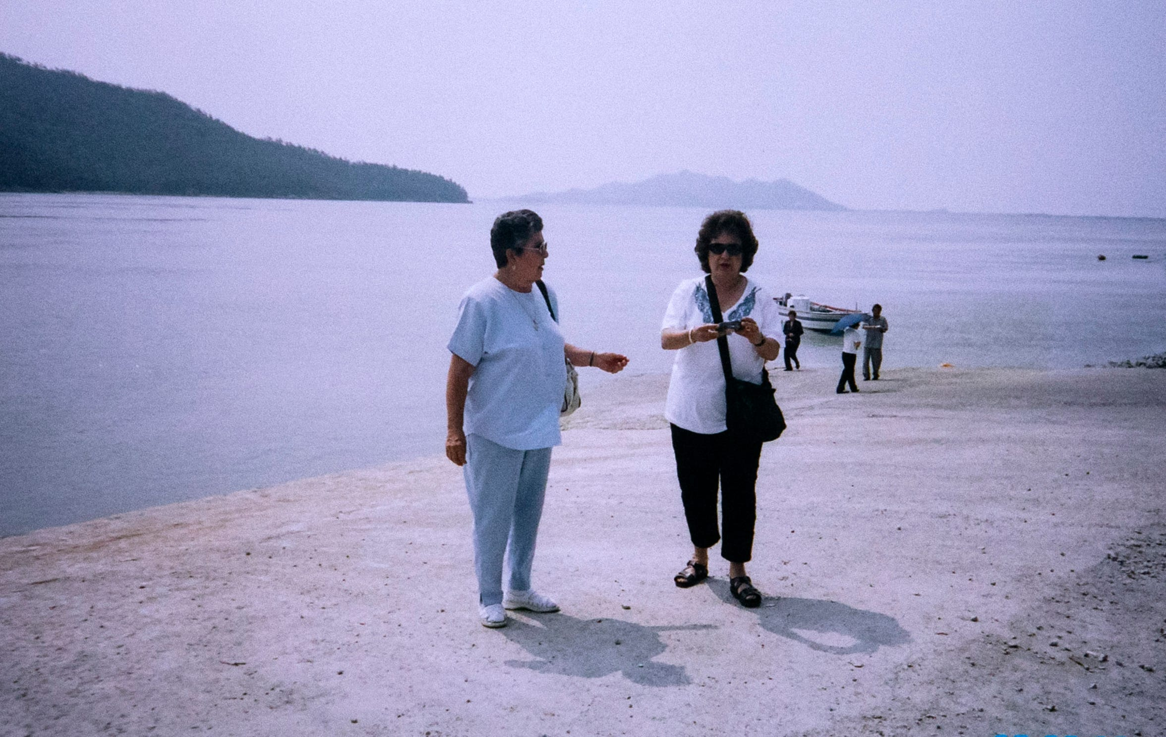 Jovita Campos (left) and Jennie Campos tour the southwest portion of South Korea on the shore of the Yellow Sea in June 2002. This location is close to where Joe Campos' (Jovita's husband and Jennie's father) B-26 ditched into the Yellow Sea on June 28, 1950. It is believed that Joe was the first person killed in the Korean War when his plane went down.