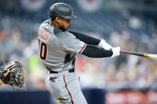 Arizona Diamondbacks' Adam Jones hits a solo home run during the first inning of a baseball game against the San Diego Padres in San Diego, Monday, April 1, 2019.