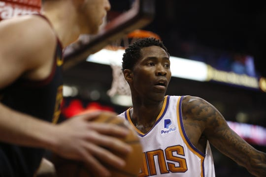 Suns' Jamal Crawford (11) covers Cavaliers' Nik Stauskas (1) as he inbounds the ball during the second half at Talking Stick Resort Arena in Phoenix, Ariz. on April 1, 2019.