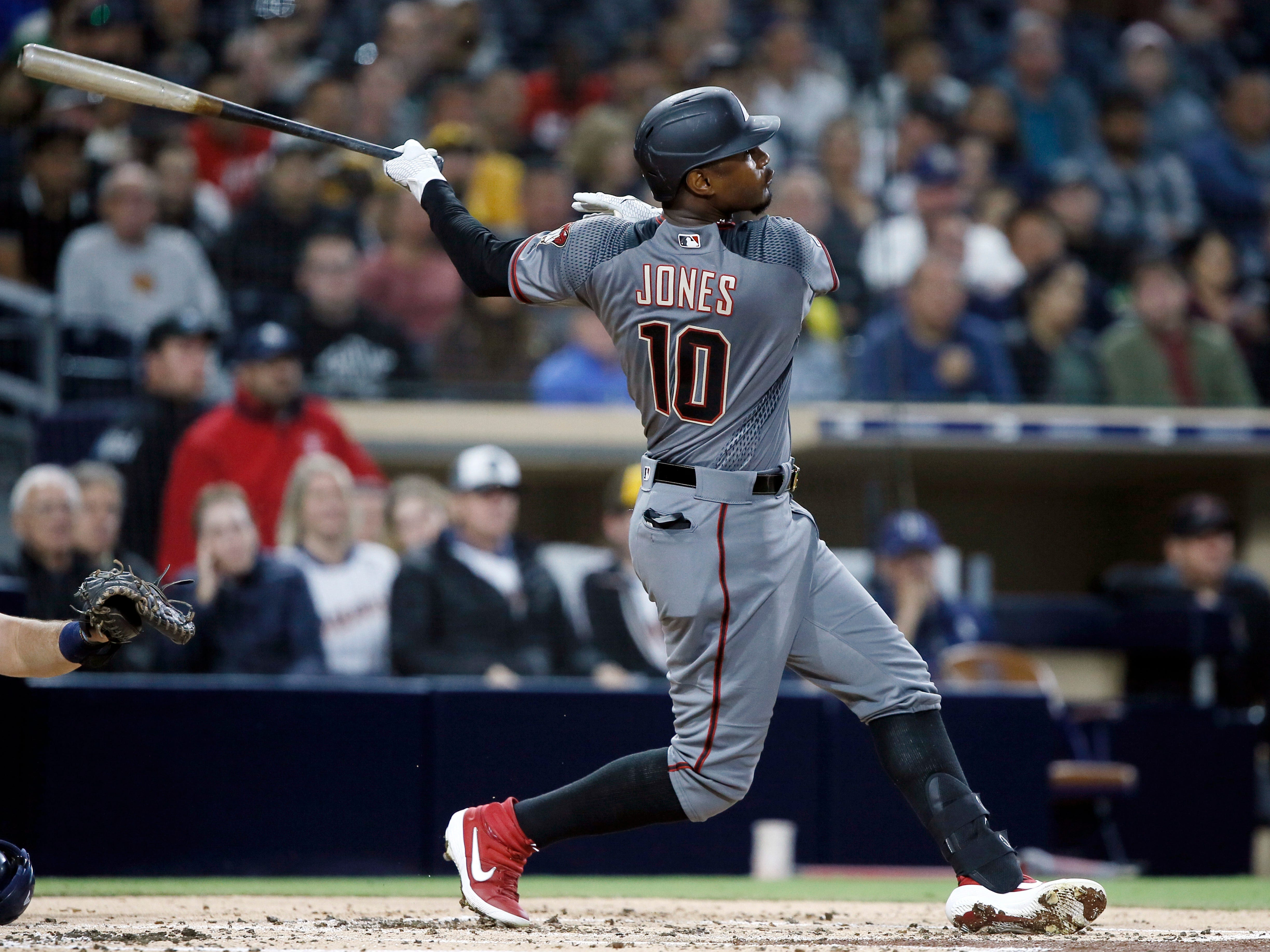 Arizona Diamondbacks' Adam Jones hits a single during the second inning of a baseball game against the San Diego Padres in San Diego, Monday, April 1, 2019. (AP Photo/Alex Gallardo)