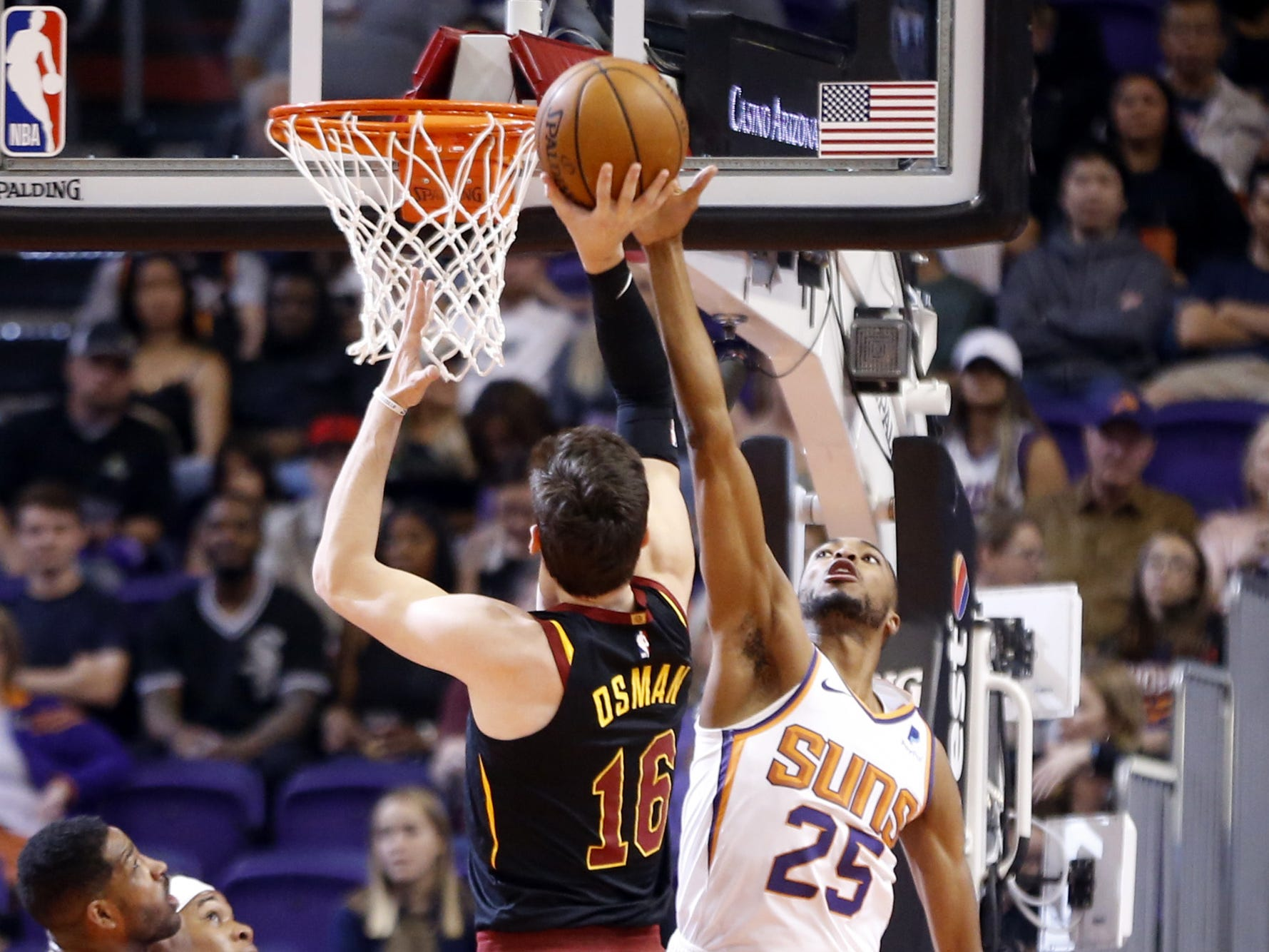 Suns' Mikal Bridges (25) blocks a shot against Cavaliers' Cedi Osman (16) during the first half at Talking Stick Resort Arena in Phoenix, Ariz. on April 1, 2019.