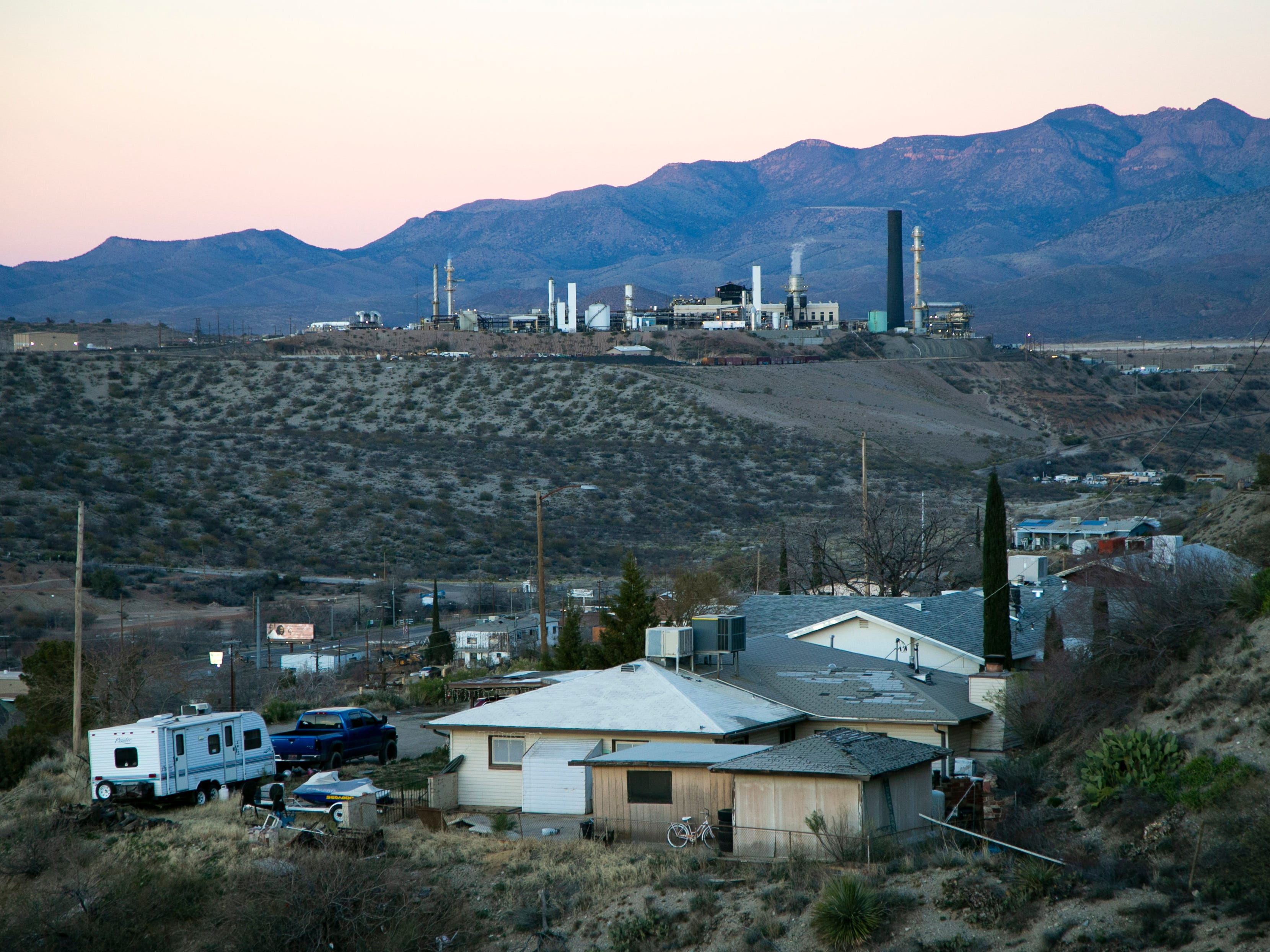 A house on a hillside in Miami, Ariz., is seen in front of the Freeport-McMoRan Copper & Gold mine in Claypool, Ariz., on January 24, 2019. Joe Campos worked at this mine in the late 1940s  which was then the Inspiration Consolidated Copper Company mine where he experienced racism because of his Mexican-American heritage. After working in the mine for several years, he re-enlisted in the military. It is believed that Staff Sgt. Joe Campos, a gunner on a B-26 bomber was likely the first American killed in the Korean War when his plane went down in the Yellow Sea on June 28, 1950.