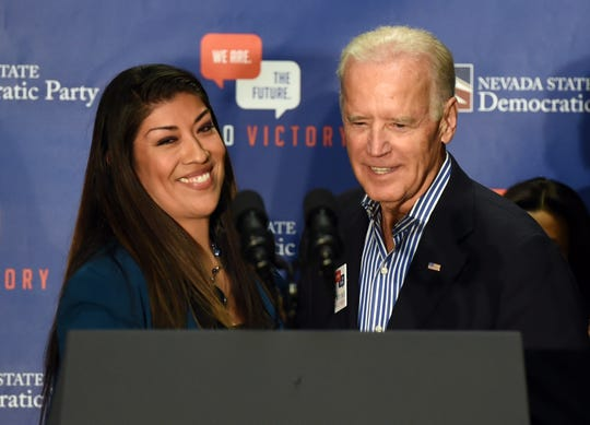 """Lucy Flores, a former Nevada assemblywoman, said Biden made her uncomfortable when he put his hands on her shoulders, smelled her hair and gave her a """"big slow kiss"""" on the back of her head at a political rally in 2014."""