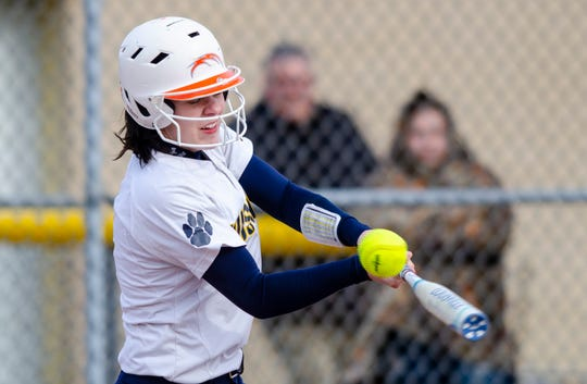 Port Huron Northern's Angel Pawlowski swings a strike during their softball match Tuesday, April 2, 2019 against St. Clair High School.