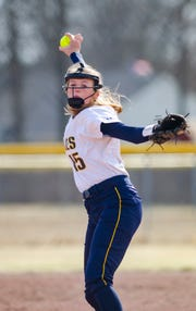 Port Huron Northern's Riley Shagena throws a pitch during their softball match Tuesday, April 2, 2019 against St. Clair High School.