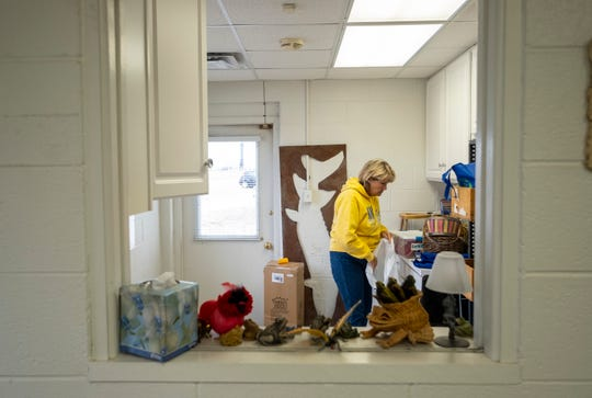 Barb Ford works to clean one of the rooms inside the Friends of the St. Clair River office Tuesday, April 2, 2019.