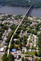 This aerial view of the Walkway Over the Hudson, taken from about 800 feet above the ground, looks west across the Hudson River from Poughkeepsie.