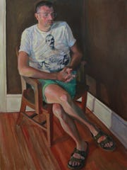 """""""Kevin,"""" by Carl Grauer, is among the portraits at Cunneen-Hackett Theater."""