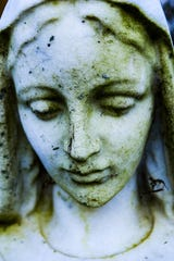 Photographer Nikki Hung exhibits photographs of cemetery sculpture and remembrances at womenswork.art