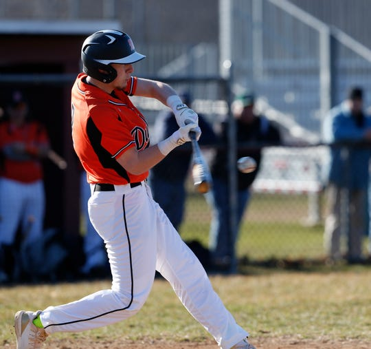 Marlboro's Sam Mongelli hits a single during an April game against Arlington.