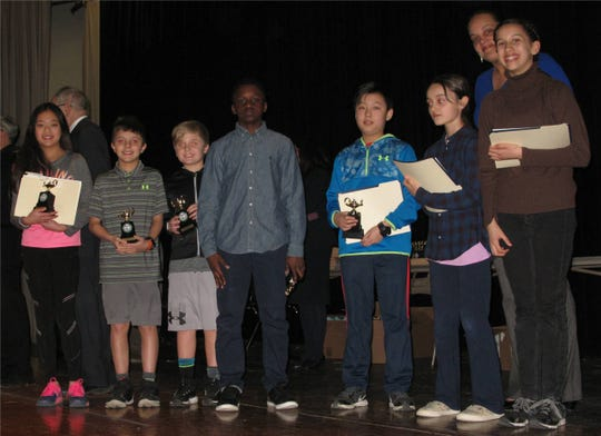 Students from Oak Grove Elementary School are recognized for their achievements in mathematics during the annual Pi Day event March 14.