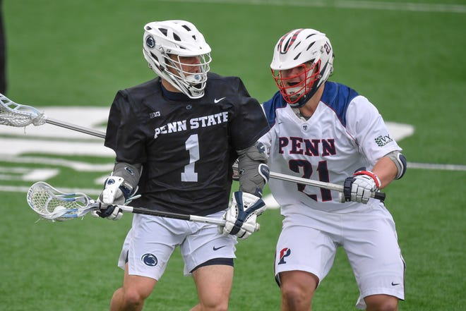 Penn State's Grant Ament, seen here at left in a file photo, had nine points in the Nittany Lions' 21-14 win over Loyola (Maryland) on Sunday in an NCAA Division I men's lacrosse quarterfinal.